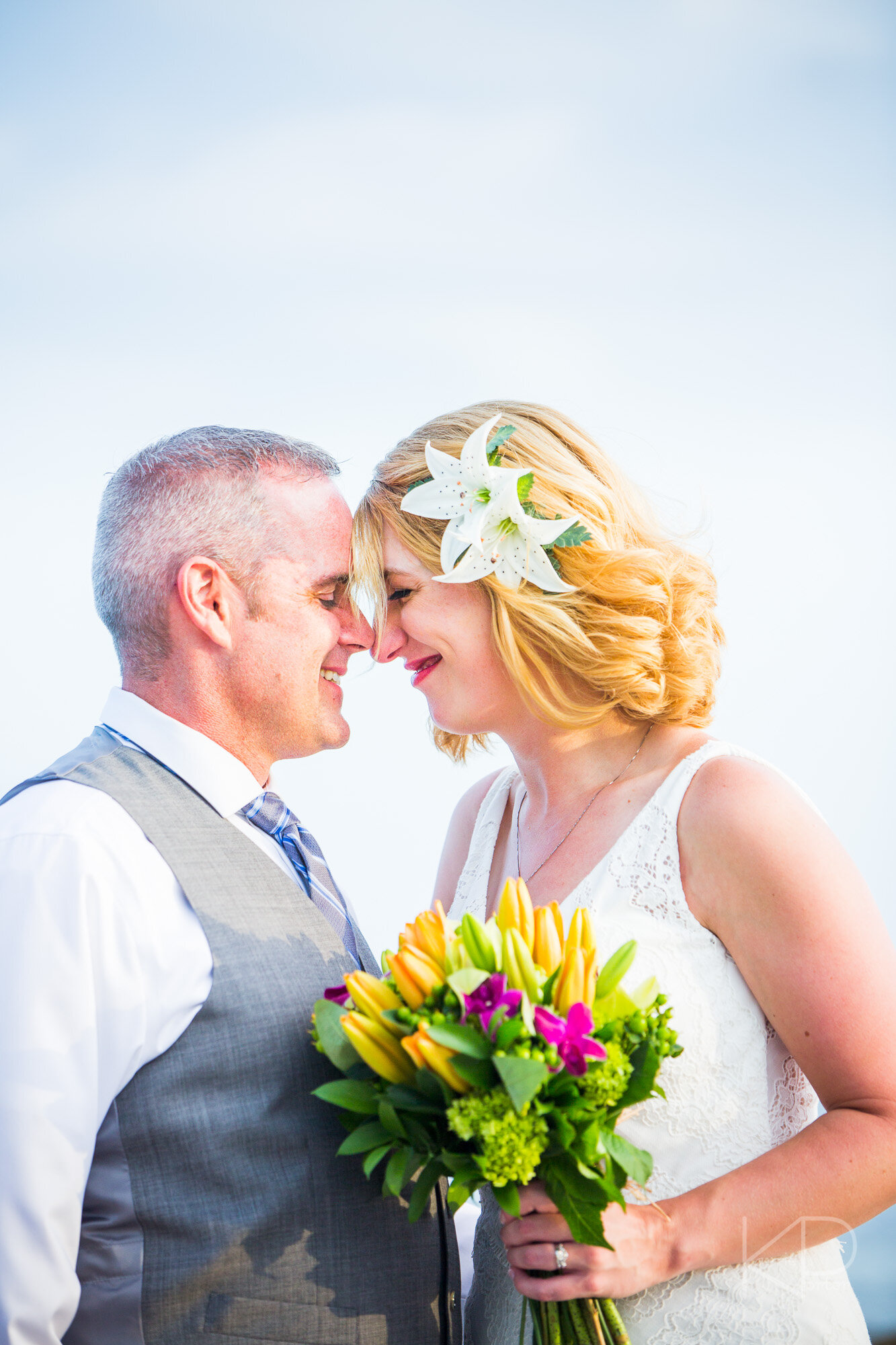 Kissing the brides head on the beach of Key West