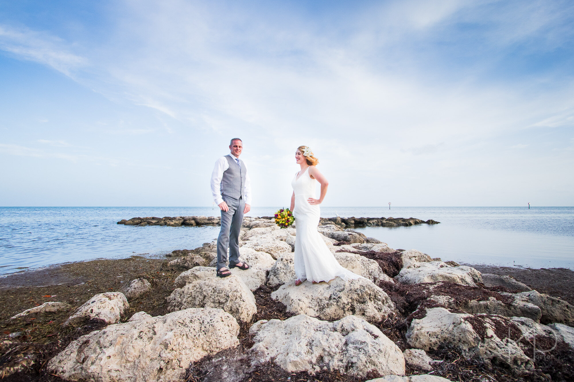Bride and groom laughing as they take pictures in Key West
