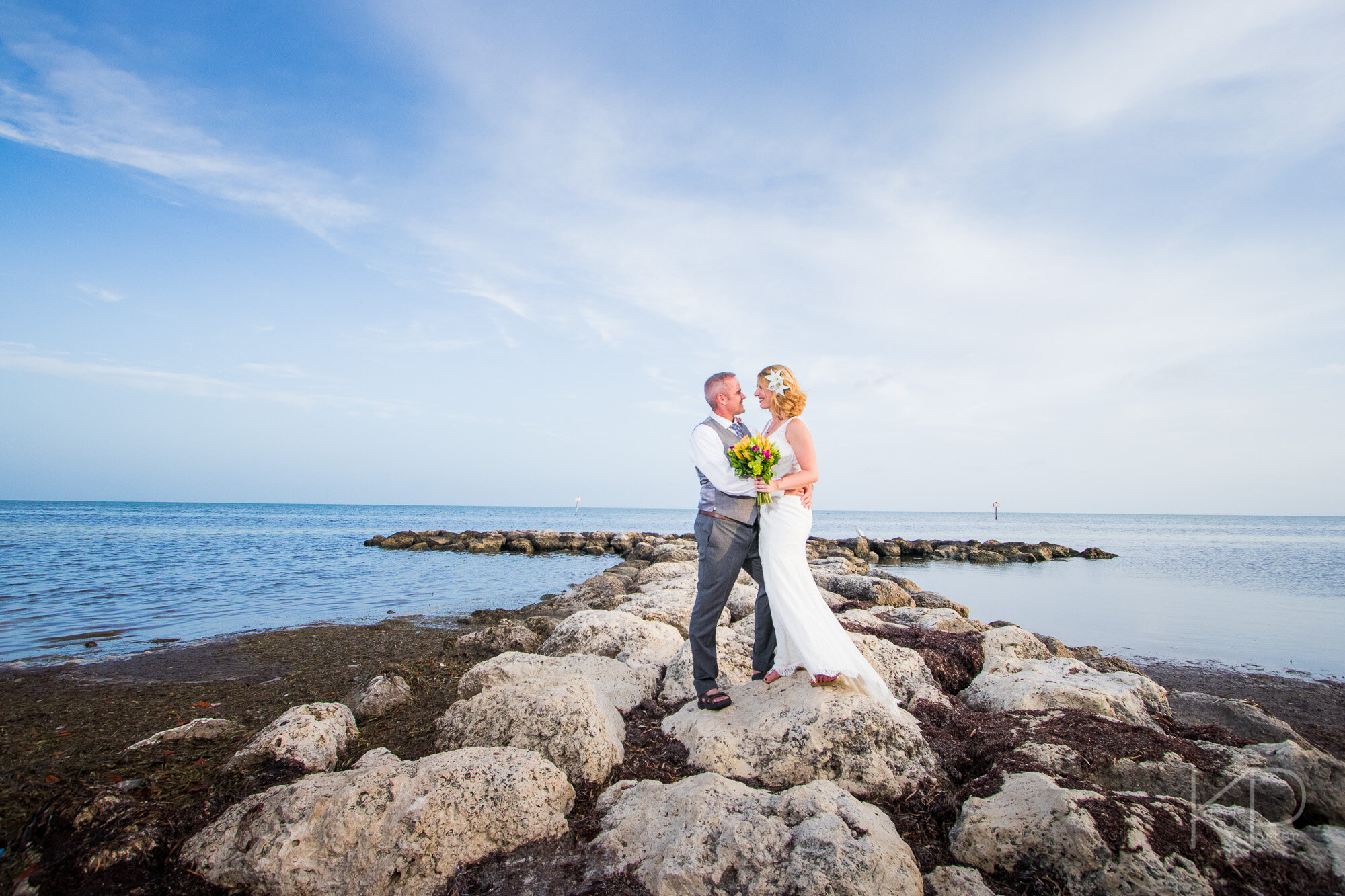 Bride and groom posing on the steps of the Key West customs house