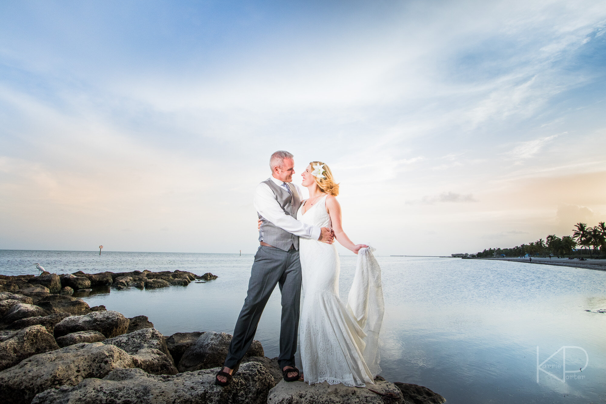 Bride and groom posing in historic building in Key West