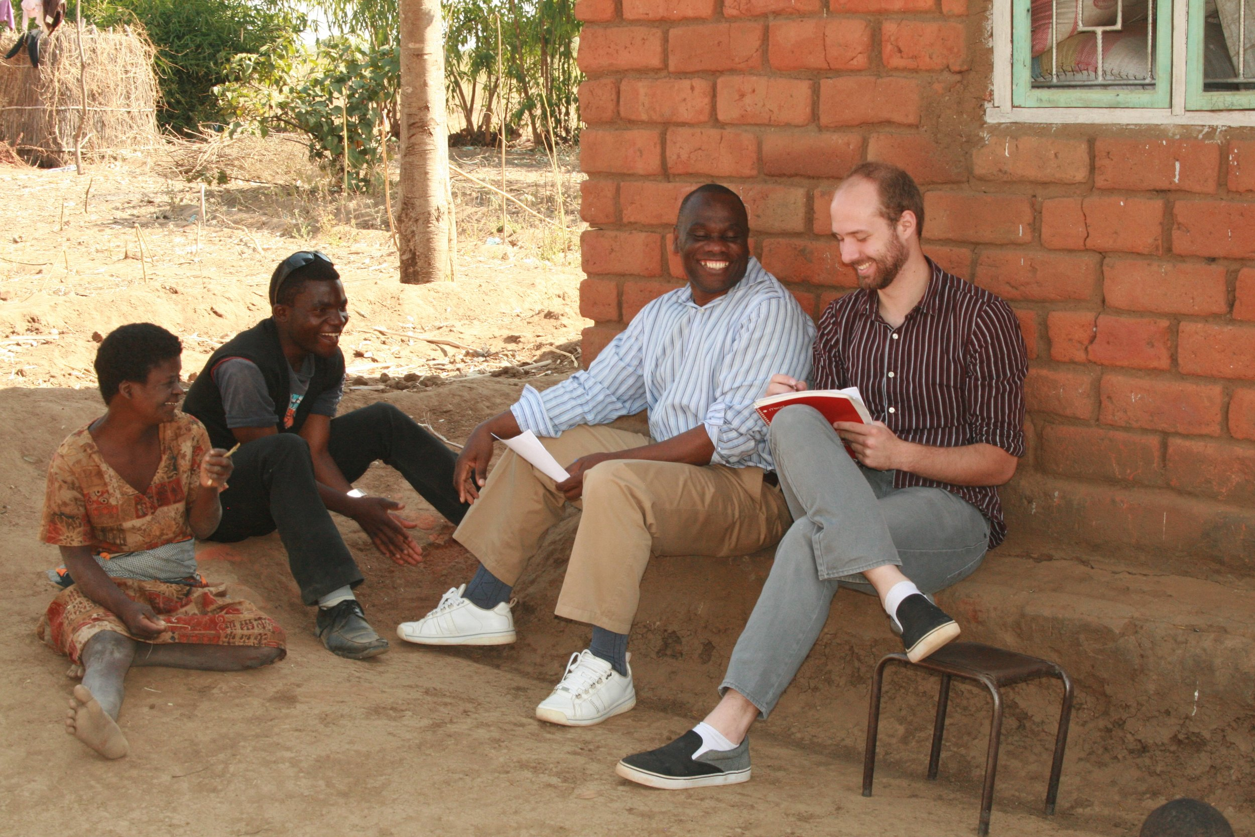 From right to left: Aaron Hauger, Zikani Kaunda, and students being interviewed.