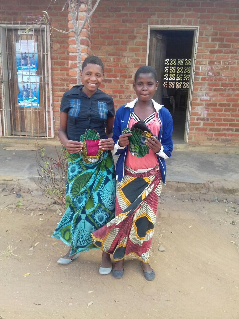 Two participants proudly show their reusable pads.