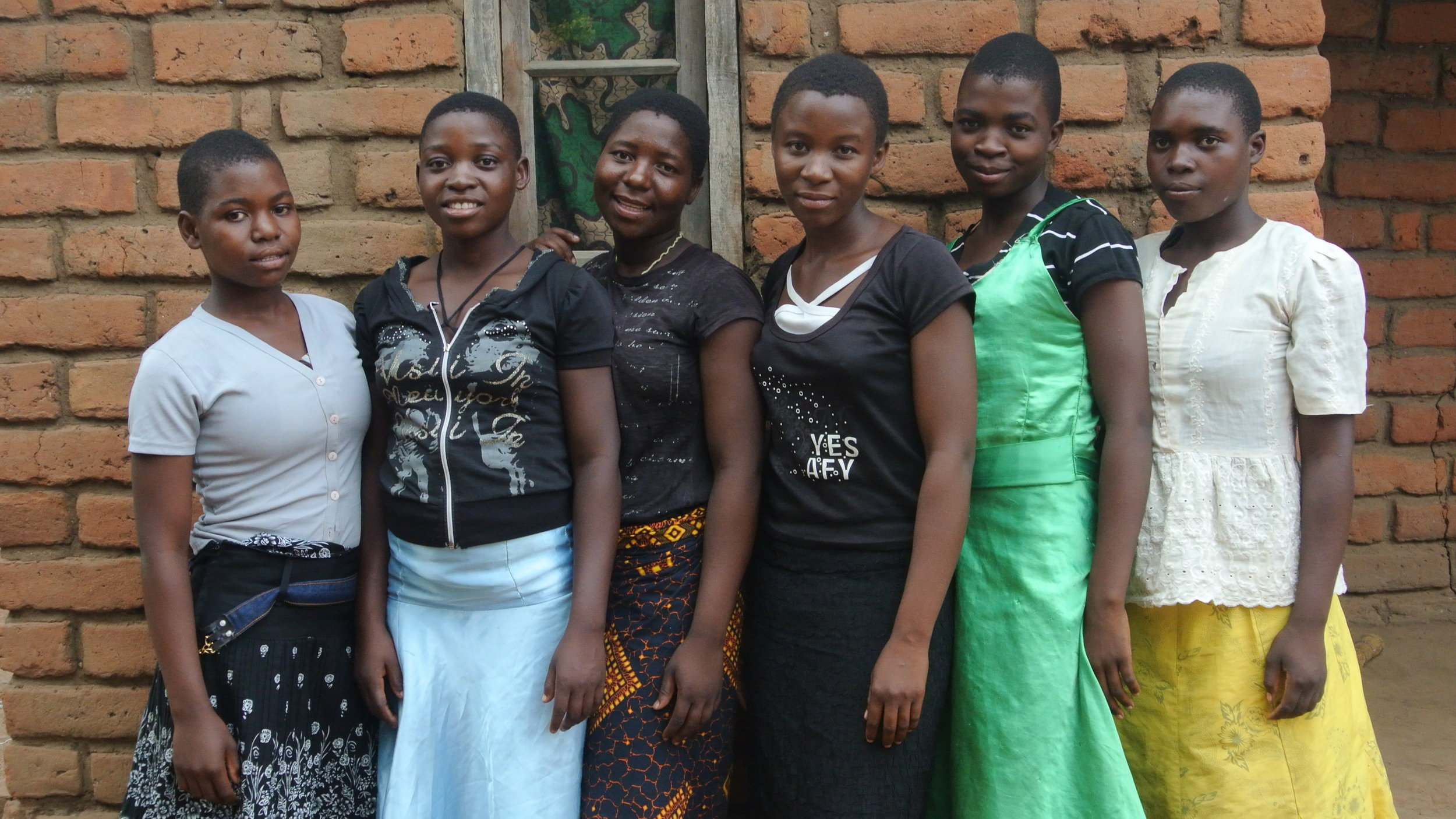 A group of young women who participate in the  Women's Empowerment Program