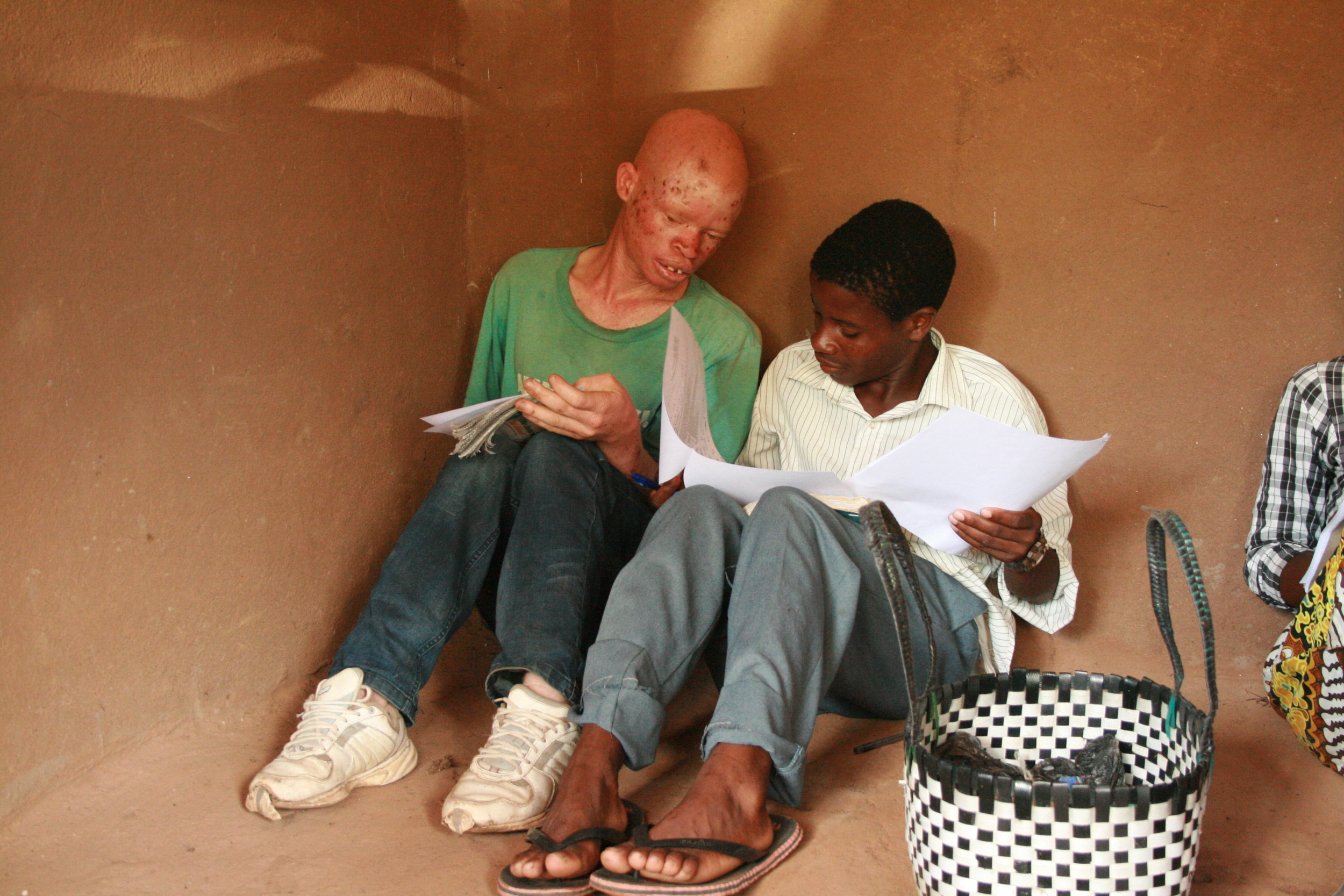 Two Secondary students, who are a part of the Standard Sponsorship Project, study together among their peers.