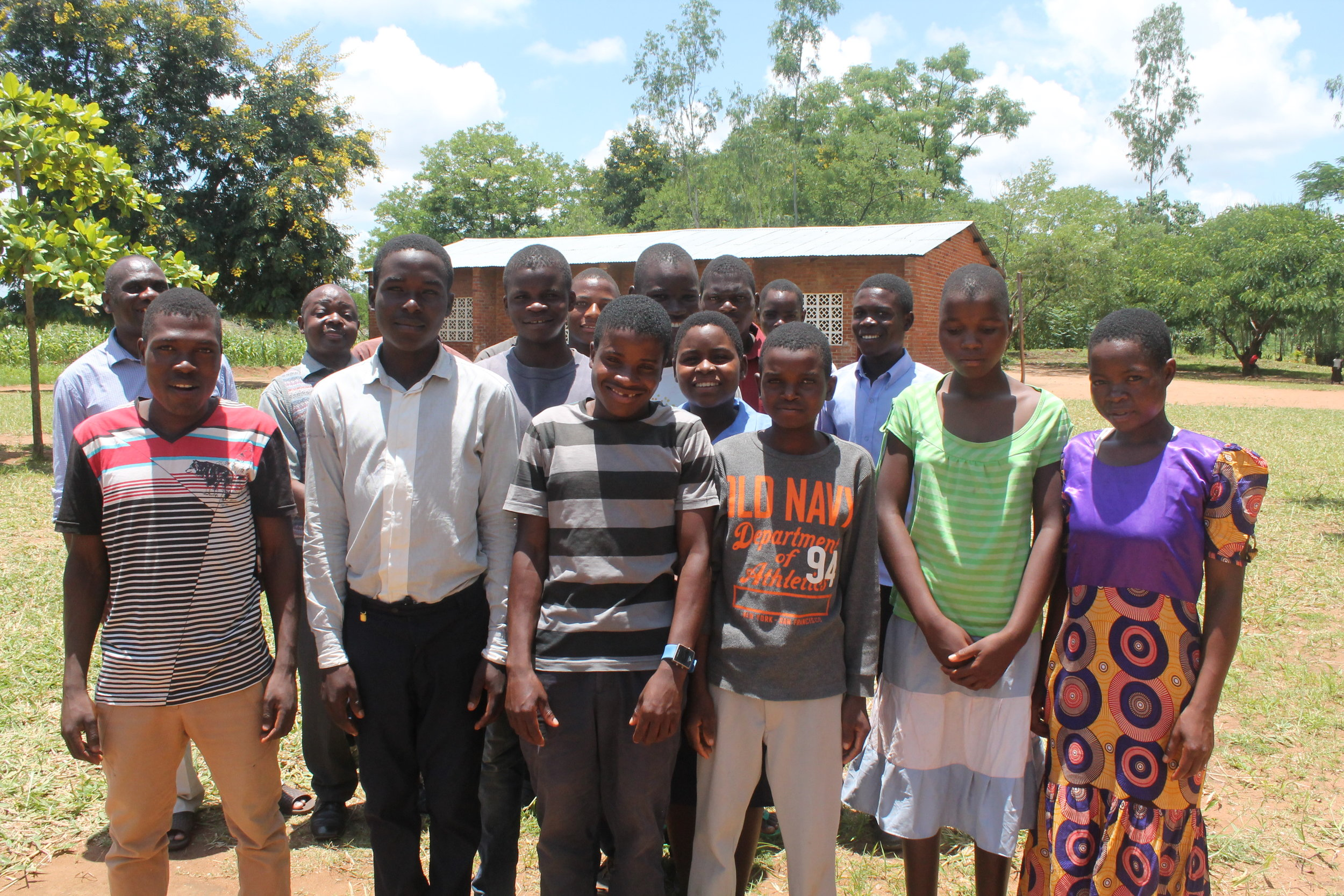 ASP and SSP students pictured with Headteacher Chapata and Mr. Mulabu, this year's Story Time Representative.