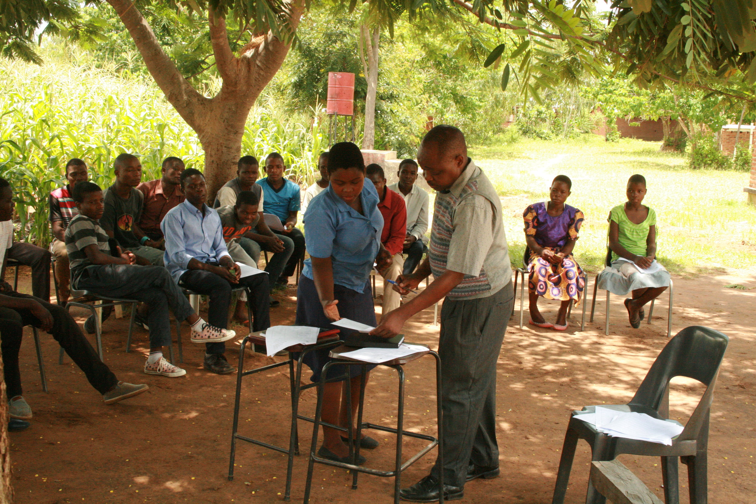 Above: SSP students sign Student Agreements with Headteacher Chapata.