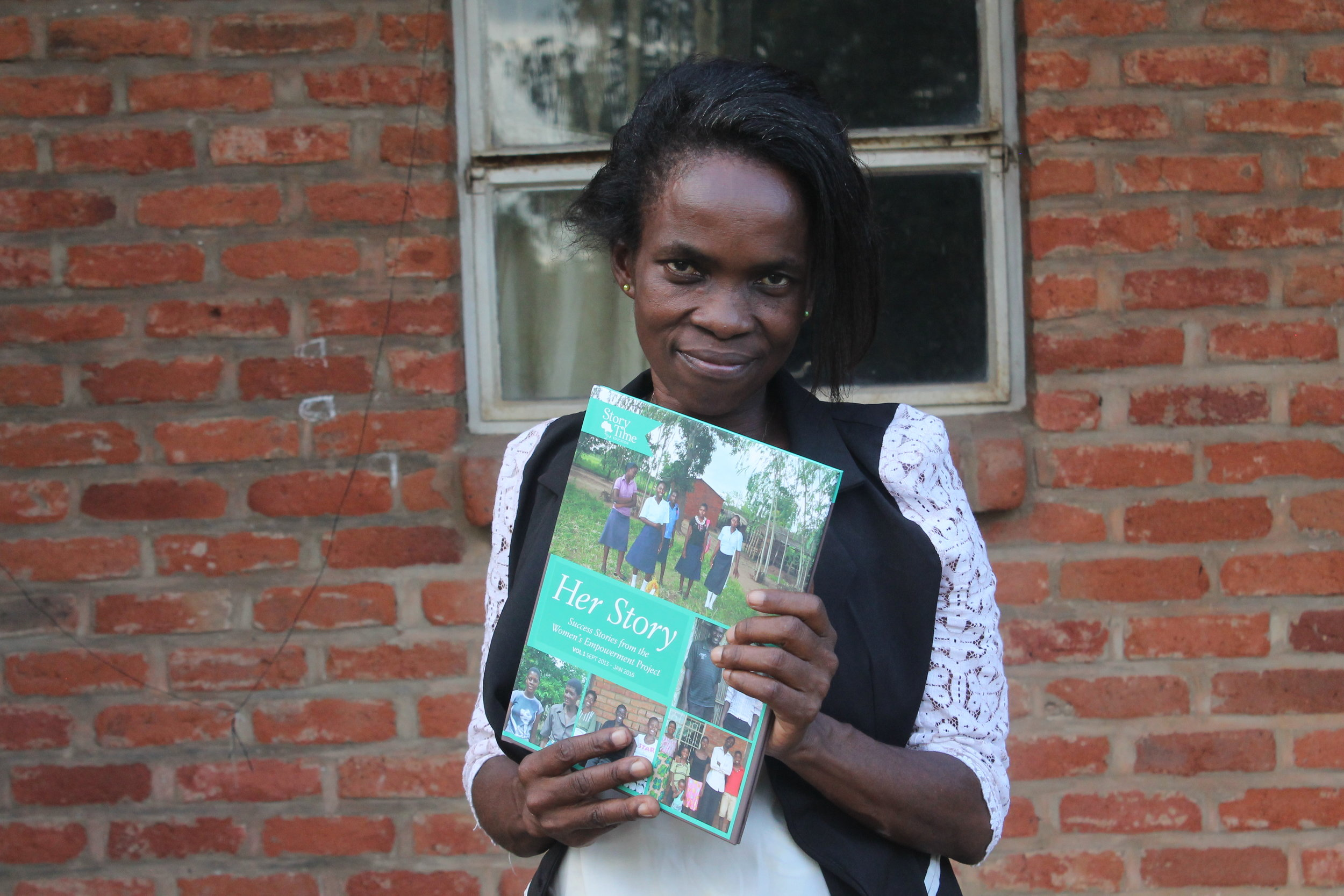 Ms. Changuya holding the First Edition of  Her Story  learn more  here.