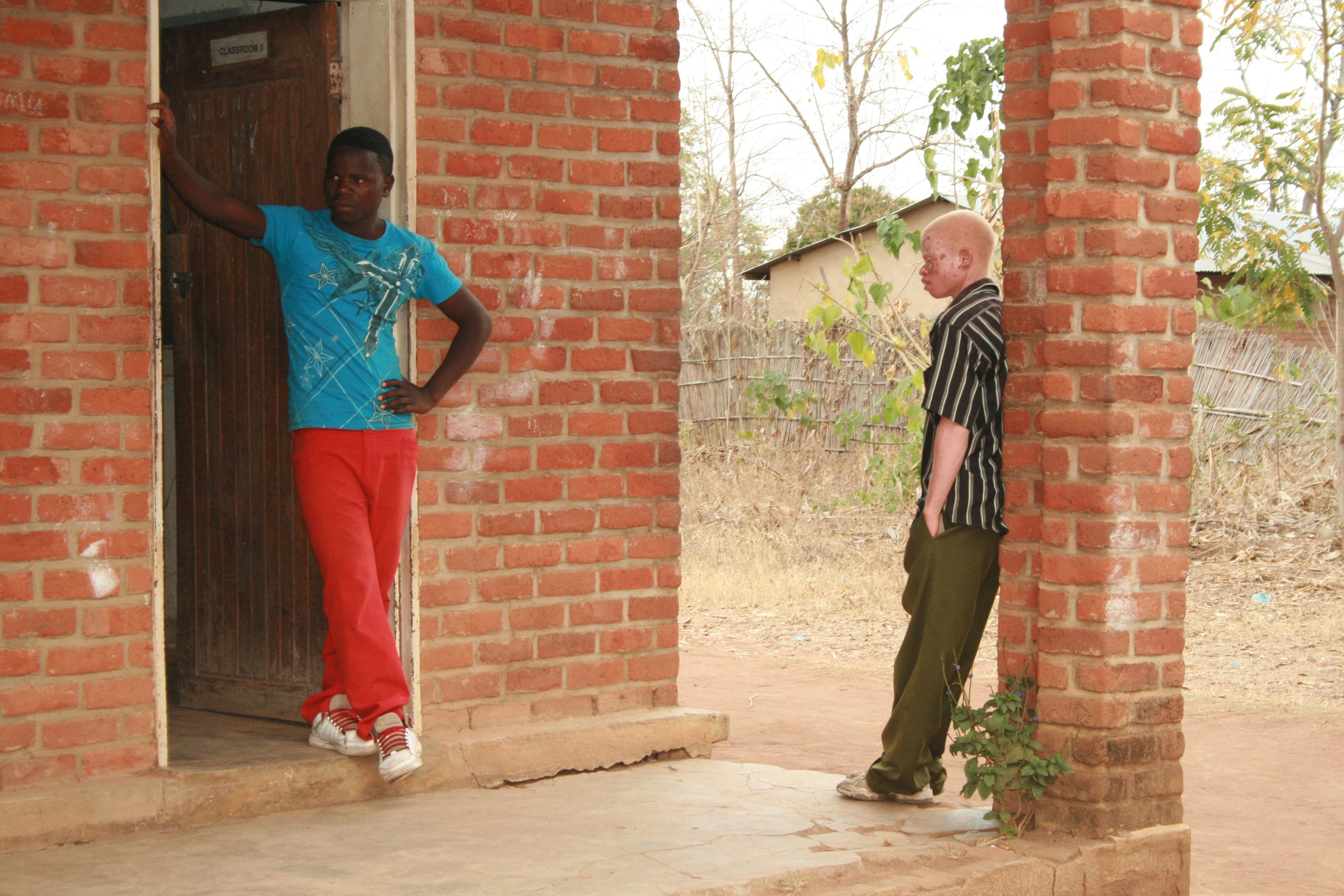 Two students wait to meet with a teacher over a weekend session.
