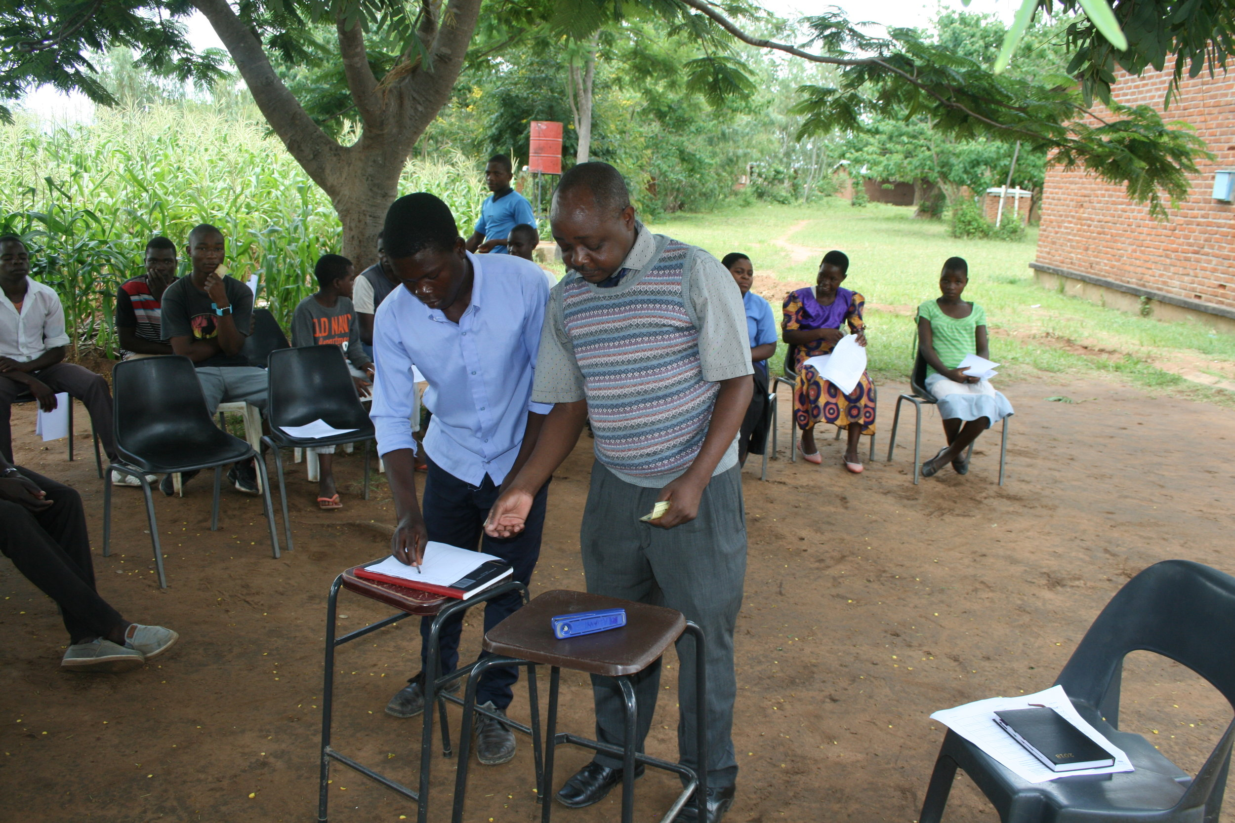 Sponsorship students sign agreements with Headteacher and their guardians.