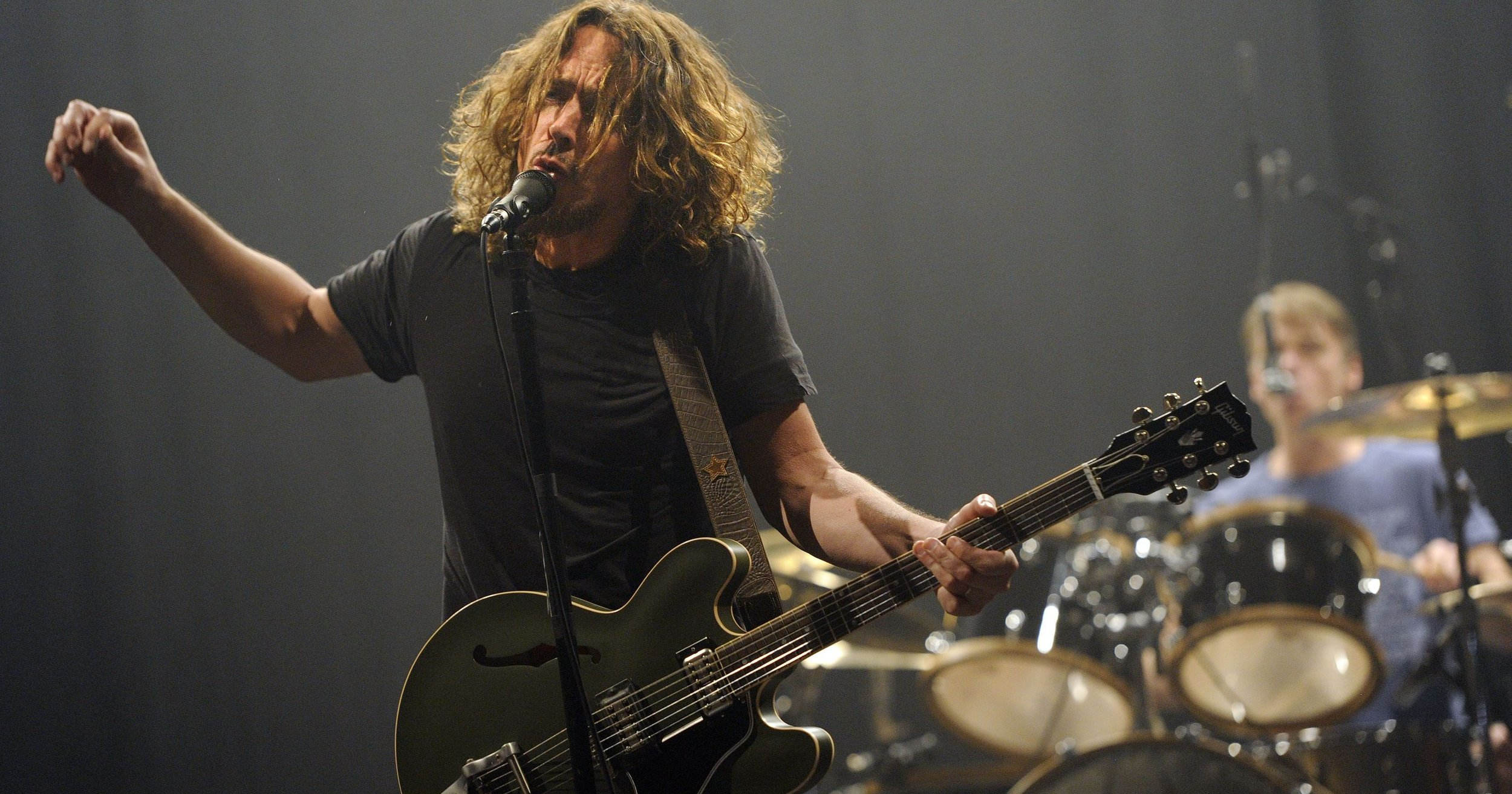 Chris Cornell performs with Soundgarden at a 2013 concert (Photo Credit: Chris Pizzello, Invision/AP)