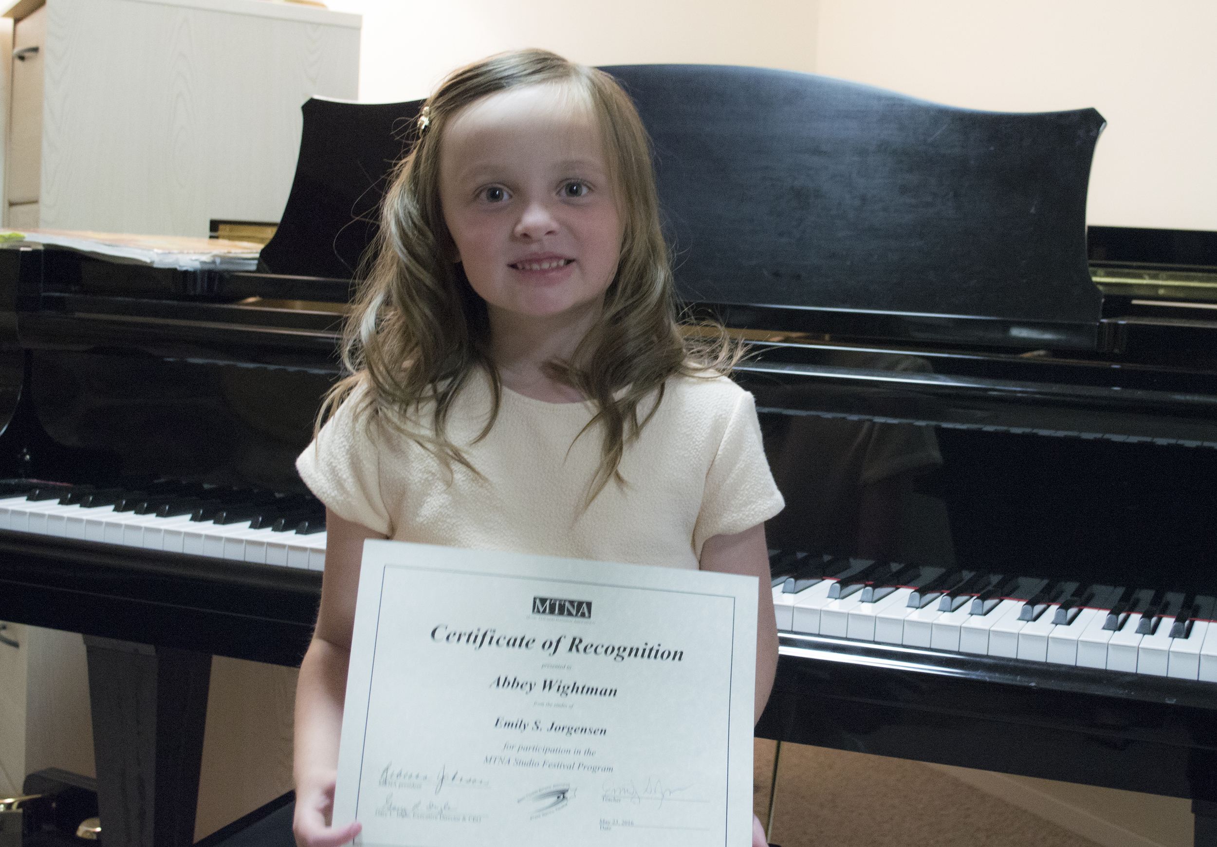 Abbey with her certificate.
