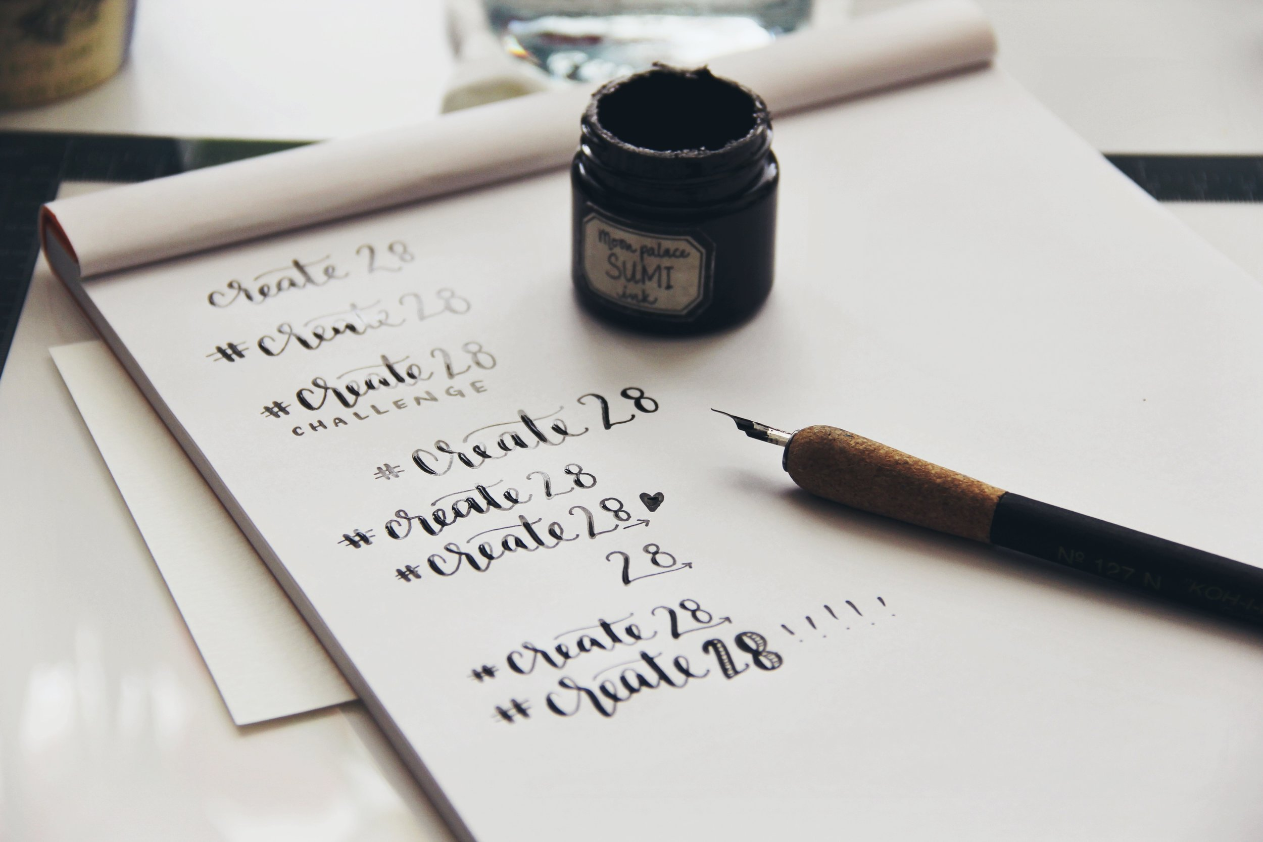 """I calligraphed a zillion """"#Create28"""" samples, with the plan to digitize one for the announcement post of this project today.Yes, I ended up tossing out all of these ideas. Not without first realizing the insane irony in ALL of this."""