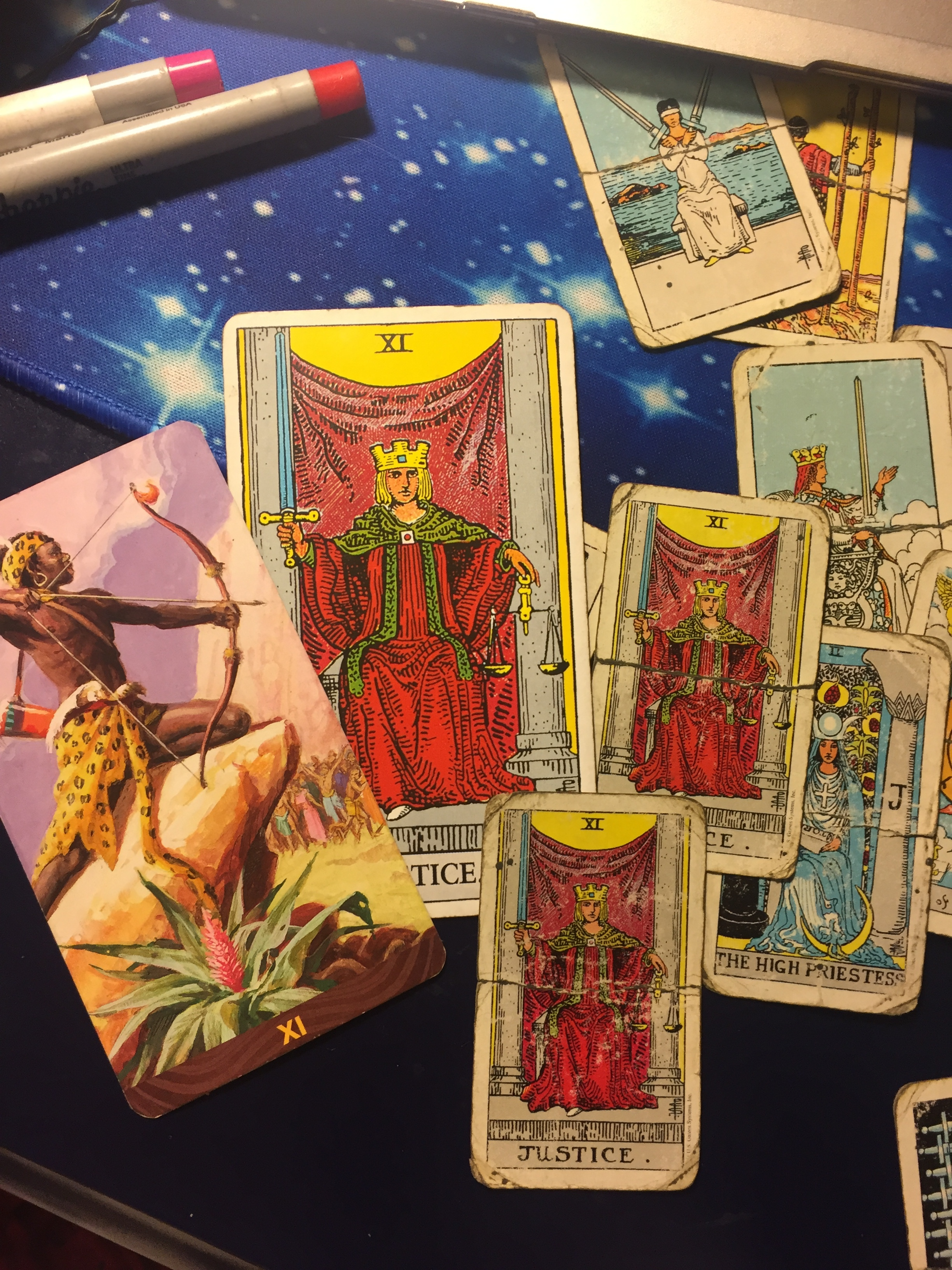 Just one of the many times she (the Justice card) has haunted my readings by layering herself so that I receive her message…  Cards used: Rider Waite Original, Rider Waite Mini, and The African American Tarot