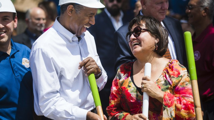 U.S. Housing and Urban Development Secretary Ben Carson shares a laugh with Ofelia Zapata, 58, while attending a groundbreaking ceremony Wednesday at Pathways at Goodrich Place, an Austin public housing redevelopment. AMANDA VOISARD / AMERICAN-STATESMAN