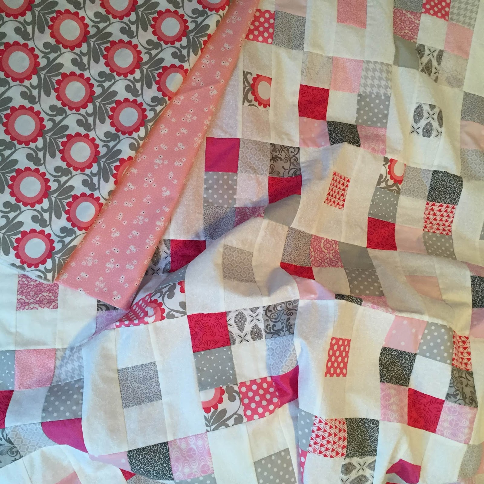 In progress...pink and gray quilt for a friends baby. LOVE!