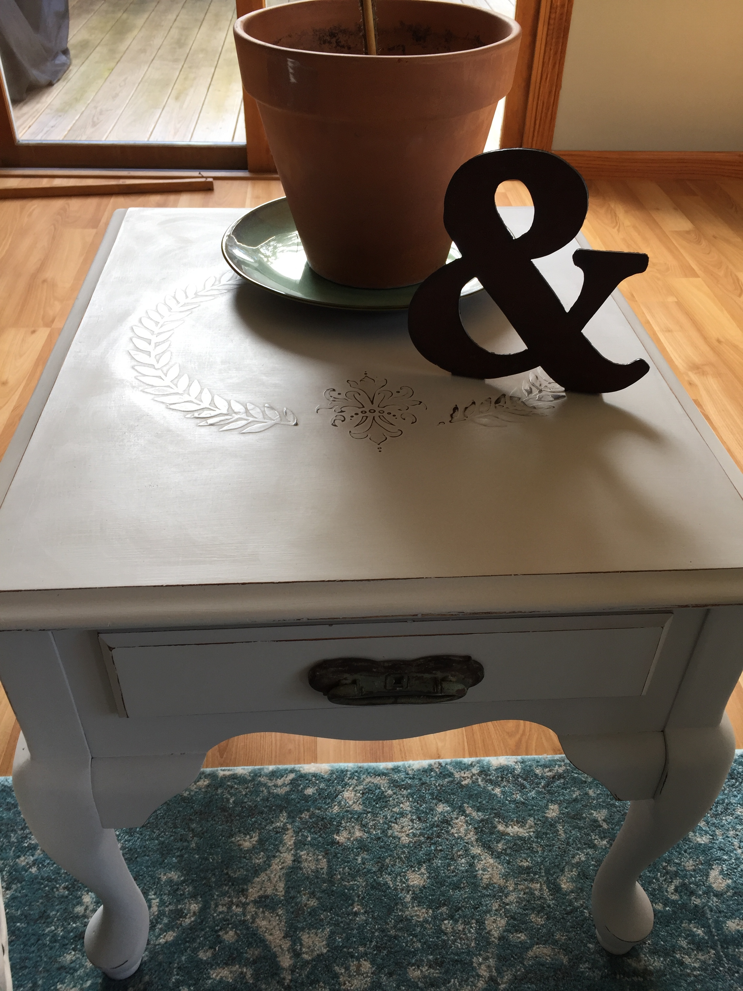 The top of this Queen Annes table top got the royal treatment with embossing plaster and now is one-of-a-kind!