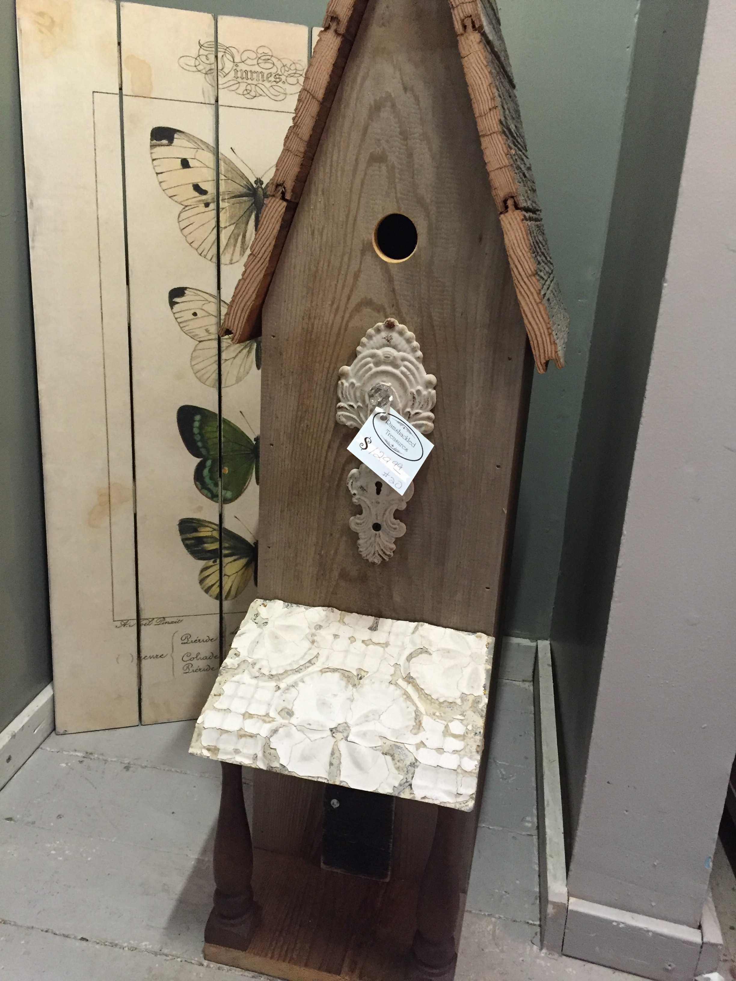 13. Add some texture and height to any space with on of our handmade birdhouses. We love the salvage elements!
