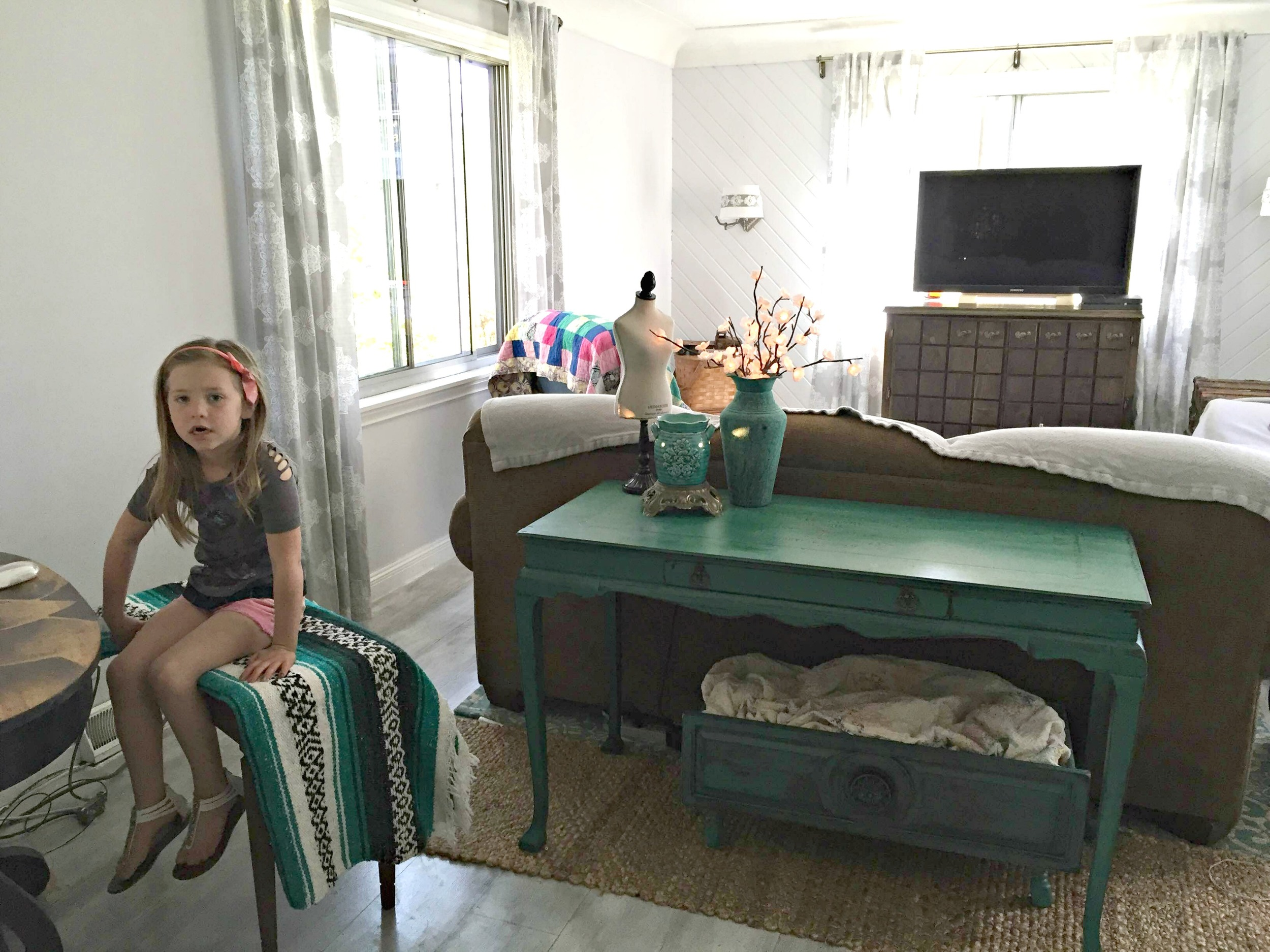 Sarah's daughter, Elsie, hanging out in their cozy family room.