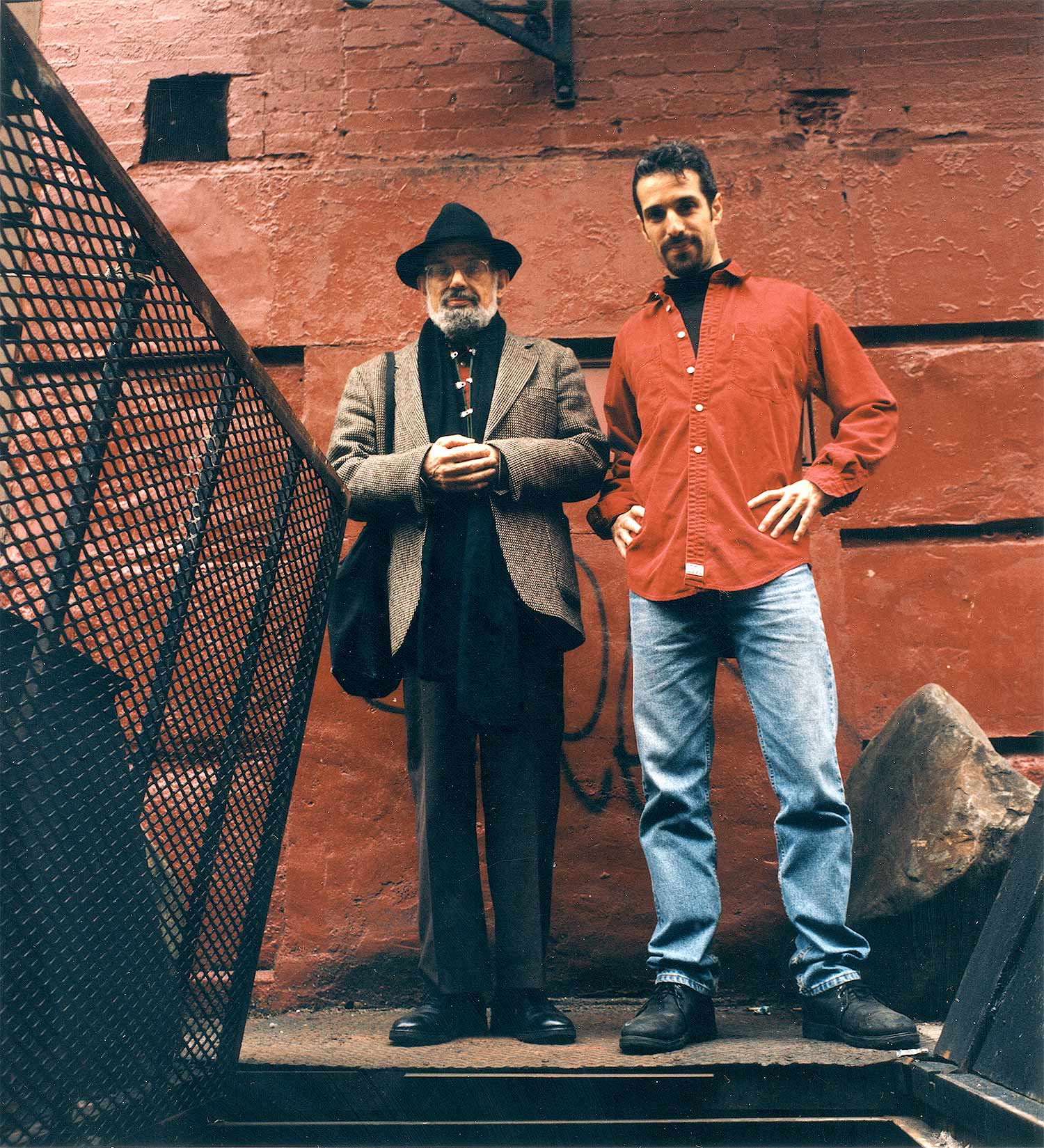 Allen Ginsberg & Eric Drooker on East 10th Street, NY City.   Photo ©1996 Denise Keim