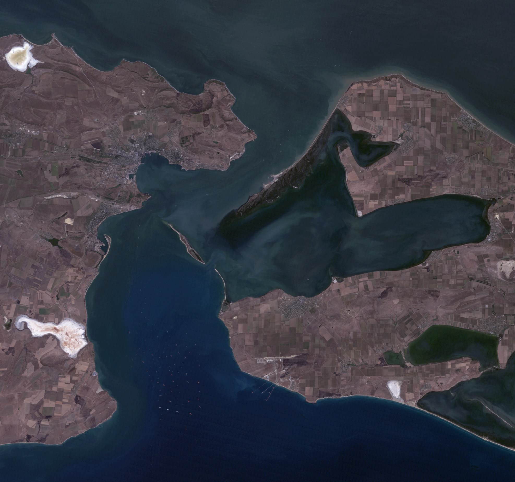 The Kerch Strait between the Sea of Azov (top), the Russian Federal Subject of Krasnodar Krai (Right), the Black Sea (Bottom), and Crimea (Left).  Credit:  Image By NASA [Public domain], via Wikimedia Commons.