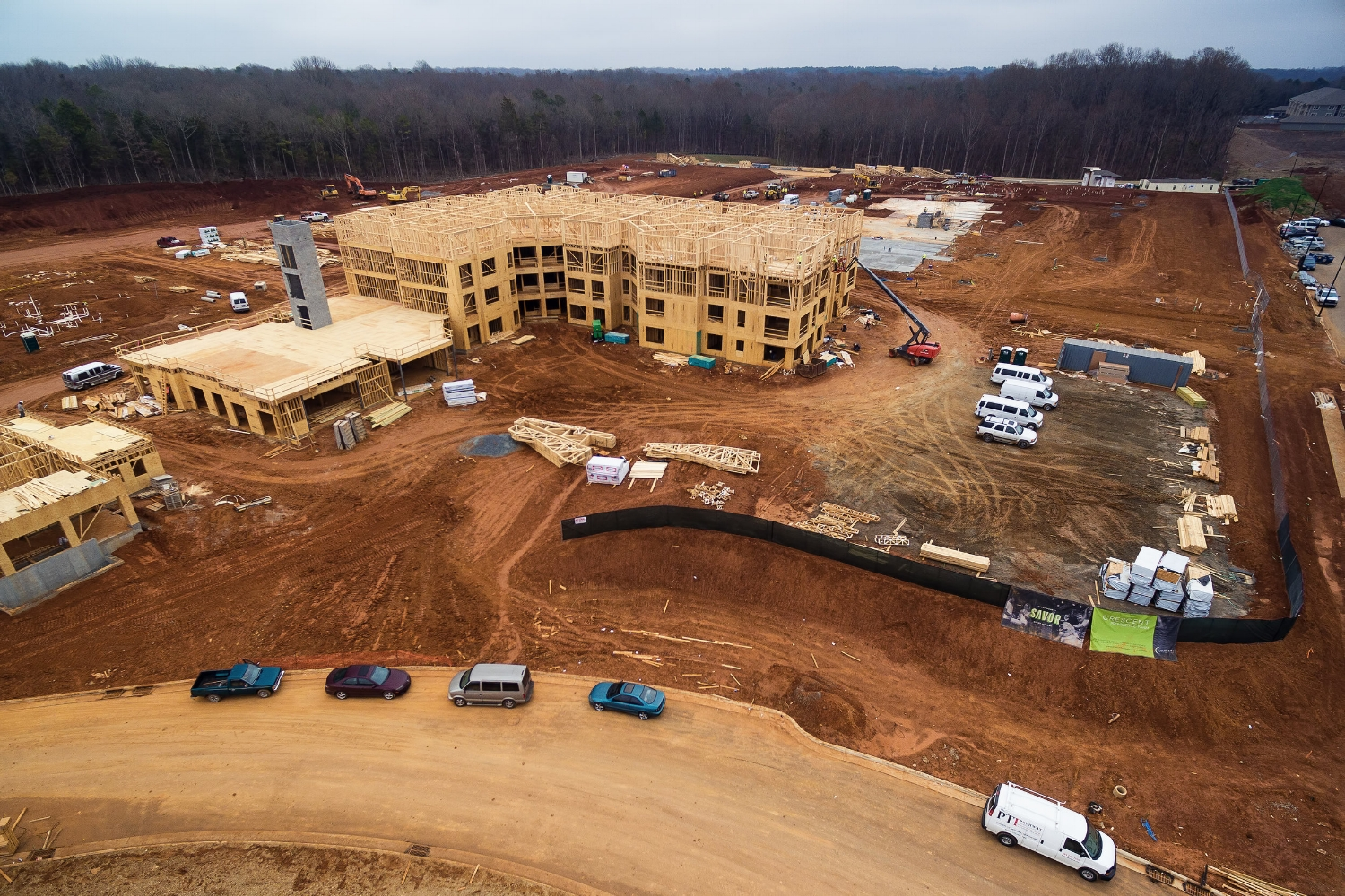 framing is well under way on a building in the crescent communities' providence farm