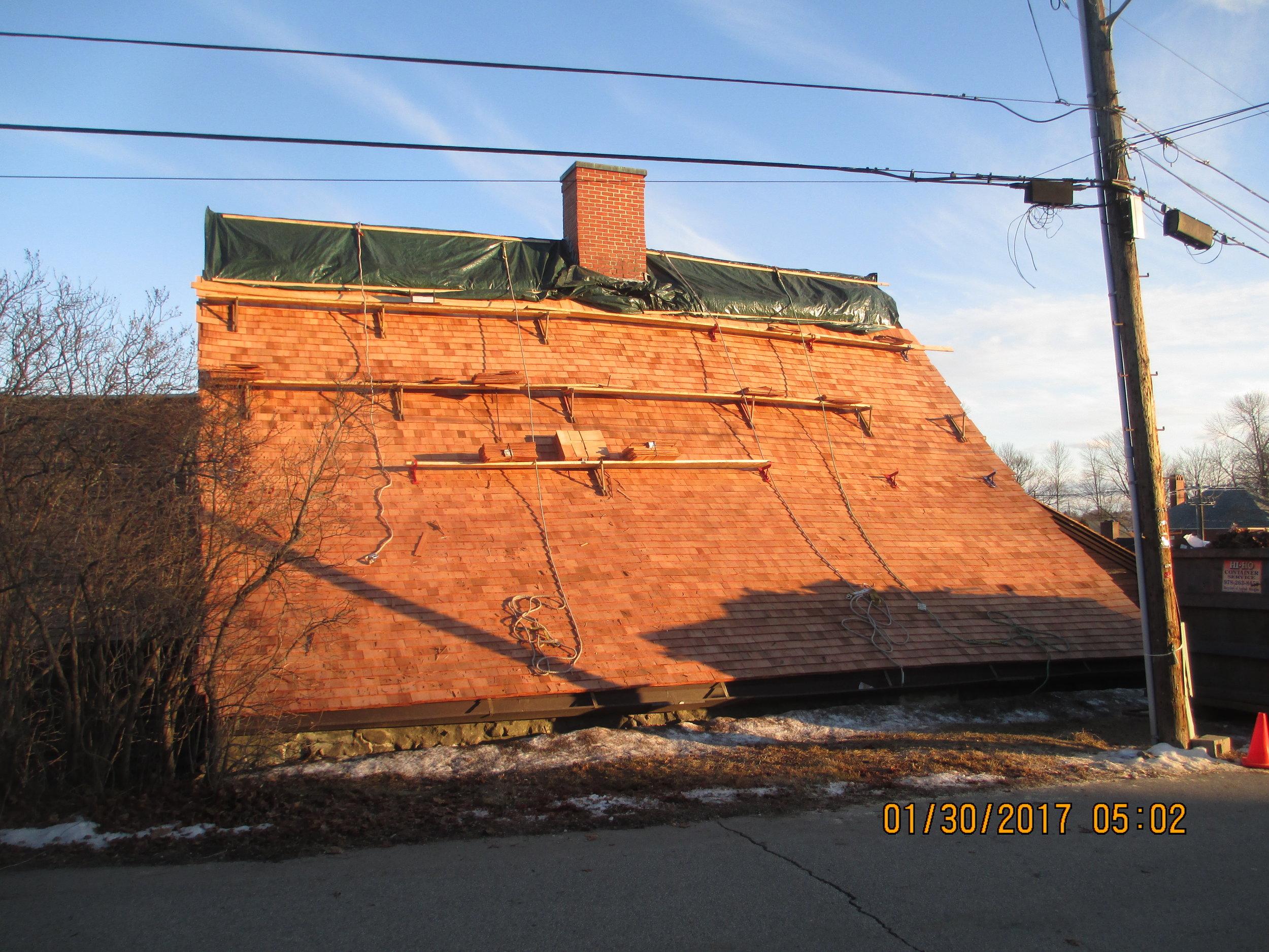 Replacing the cedar shake roof.