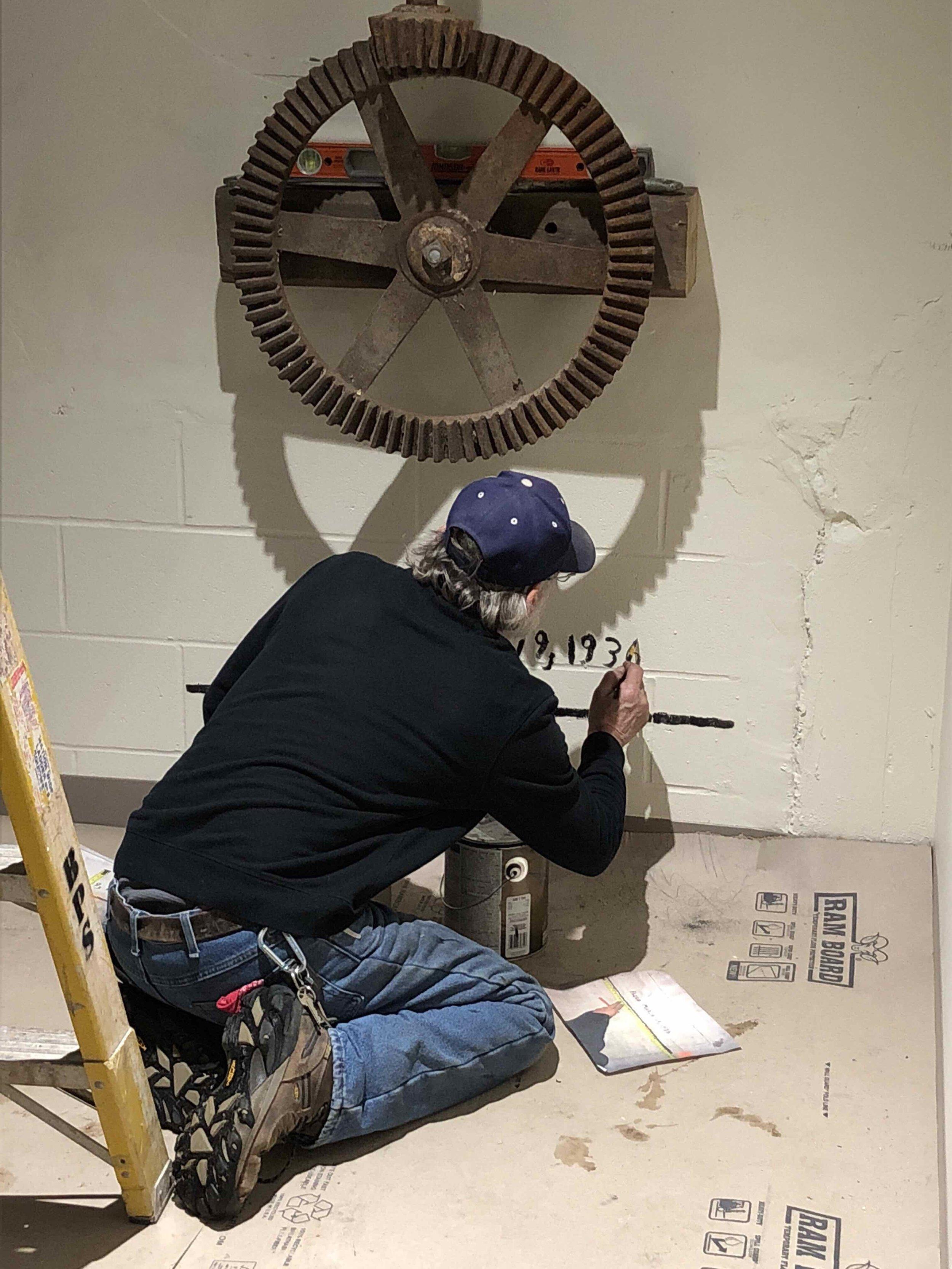 FRANKLIN.Man working on restoration.jpg