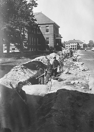 Boys digging for a cement wall at the Laconia State School. Courtesy photograph.