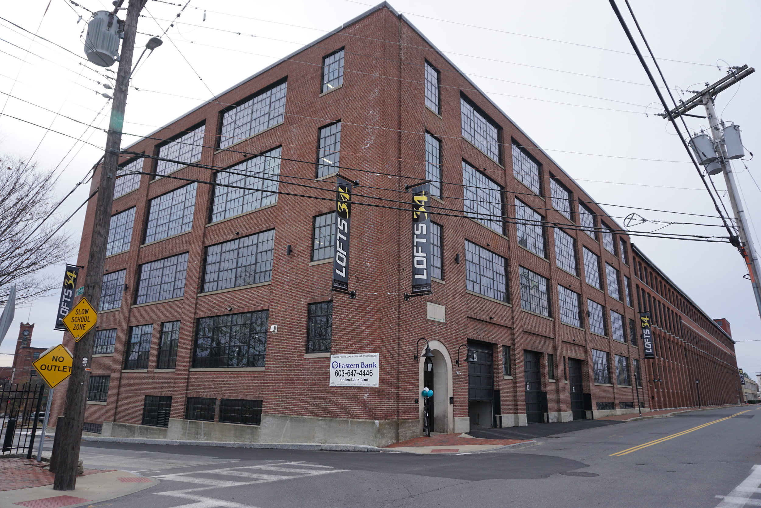 """The historic building known as the """"Card Shop"""" was part of a sprawling industrial complex in Nashua owned by the The Nashua Gummed and Coated Paper Company, whose construction began in 1889. Brady Sullivan purchased the vacant and neglected building in 2015, and since then has transformed the 300,000 sq.ft. building into a trendy home for 200 apartments. (Photo courtesy of Brady Sullivan.)"""