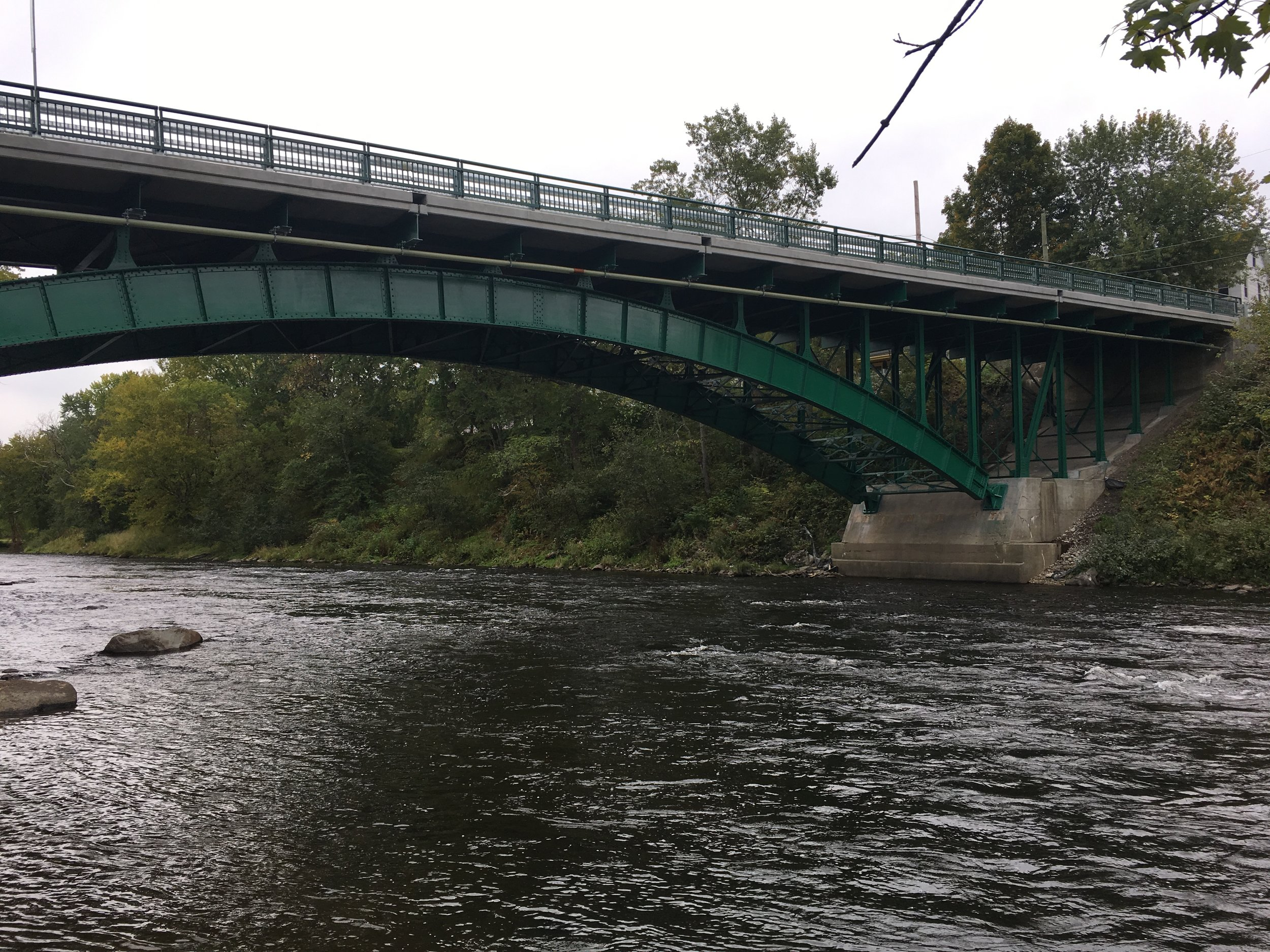 The Stewartstown Bridge, which connects its namesake town to Beecher Falls, Vermont over the Connecticut River, was one of the few remaining metal truss buildings in the state when it was placed on the Preservation Alliance's  Seven to Save  list in 2008. In 2017, the State of New Hampshire Department of Transportation launched an extensive rehabilitation process that has restored the 1931 bridge to its former glory. (Photo courtesy of NH DOT.)