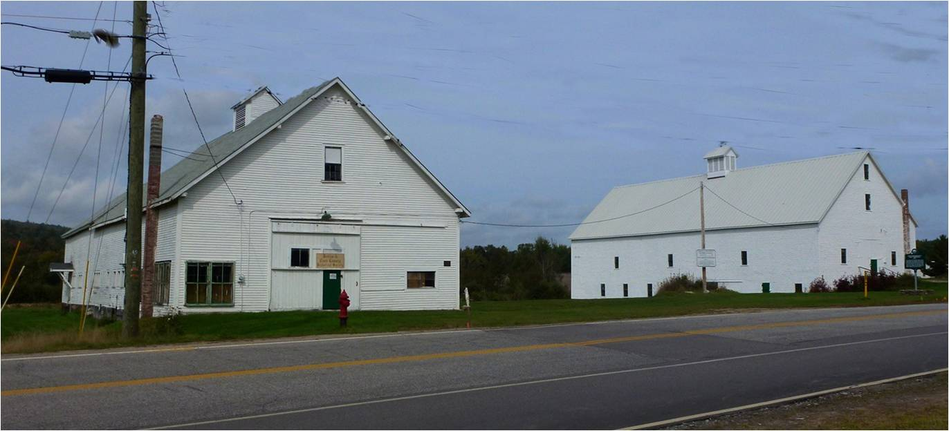 The Historical Society owns and is completing the rehabilitation of these two barns located north of downtown. The barns are the last of what remains of Brown Company Logging, and one of the buildings has connections to a Brown family member's efforts to introduce Arabian horses as a superior breed for the Calvary. (Photo courtesy of Berlin & Coos County Historical Society.)
