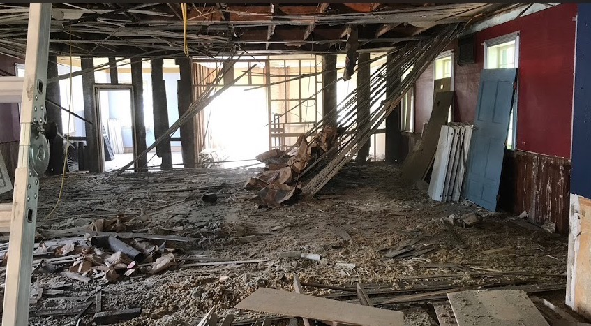 Interior renovations involved removing layers of dropped ceilings and sheetrock.