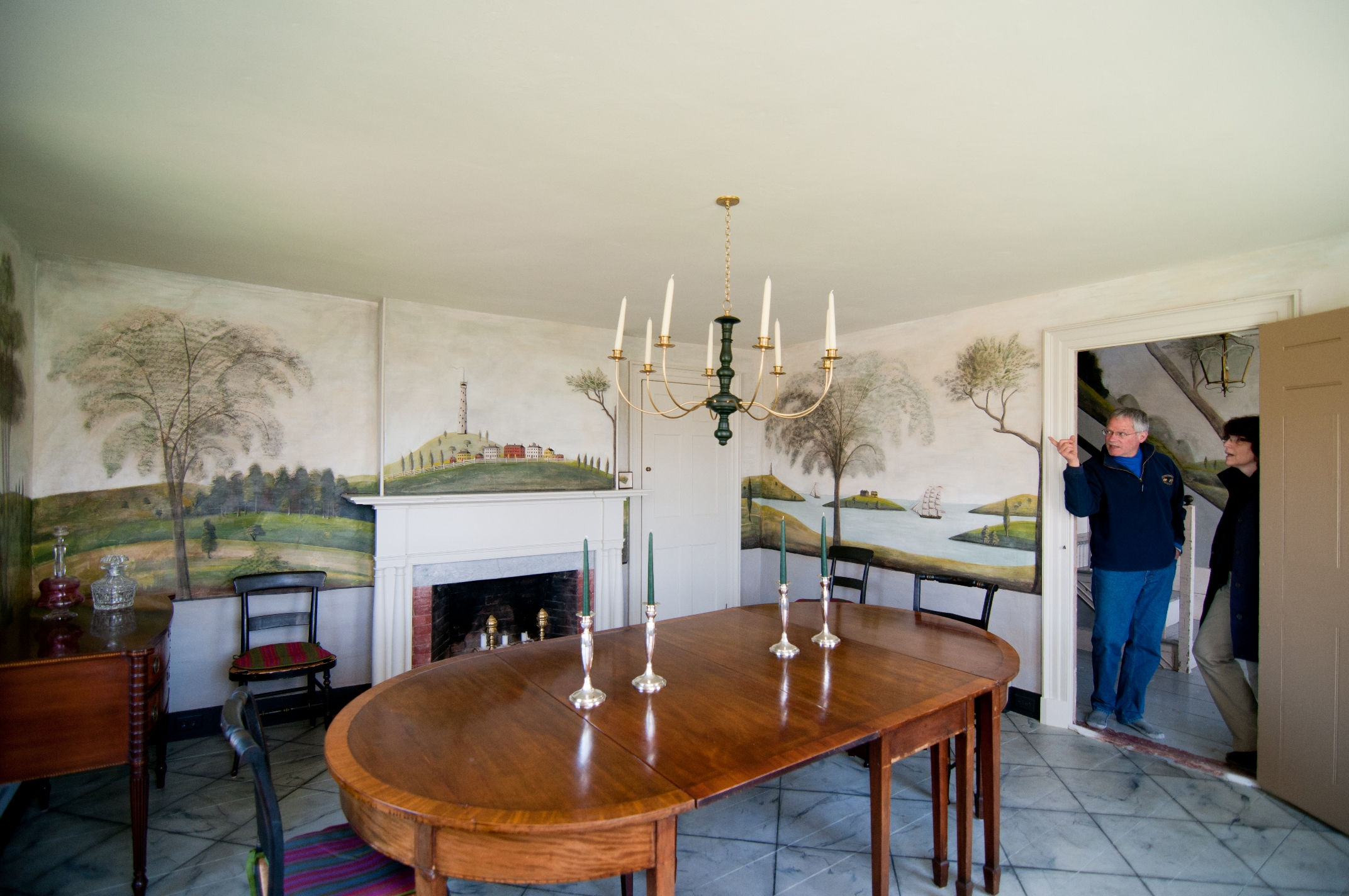 Tim Cook (at left, with former Preservation Alliance board member Sue Booth) described the preservation easement that protects his 1811 federal farmhouse with rare, intact Rufus Porter murals at the recent Passing It On program. Photo: Steve Booth