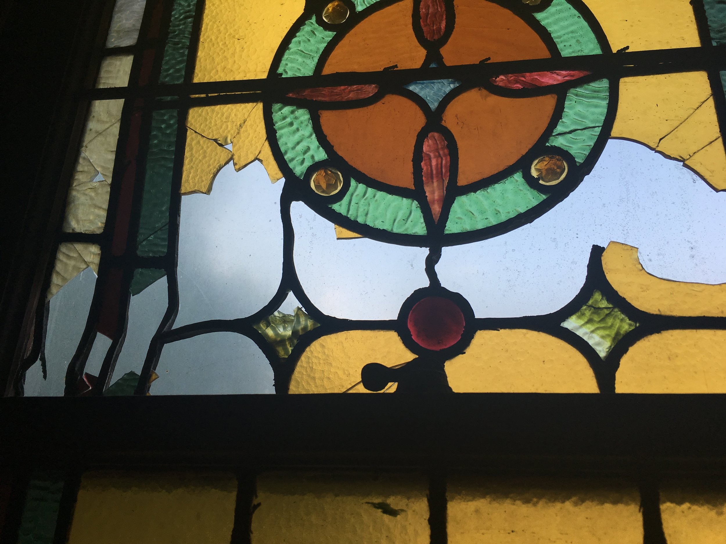 Many of the stained glass windows have been damaged since 1923 from a fire next door.