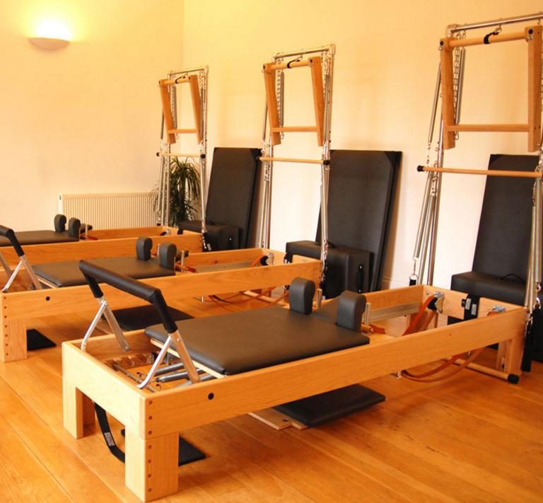 A Reformer Pilates bed  (Image courtesy of  pepilates.co.uk )
