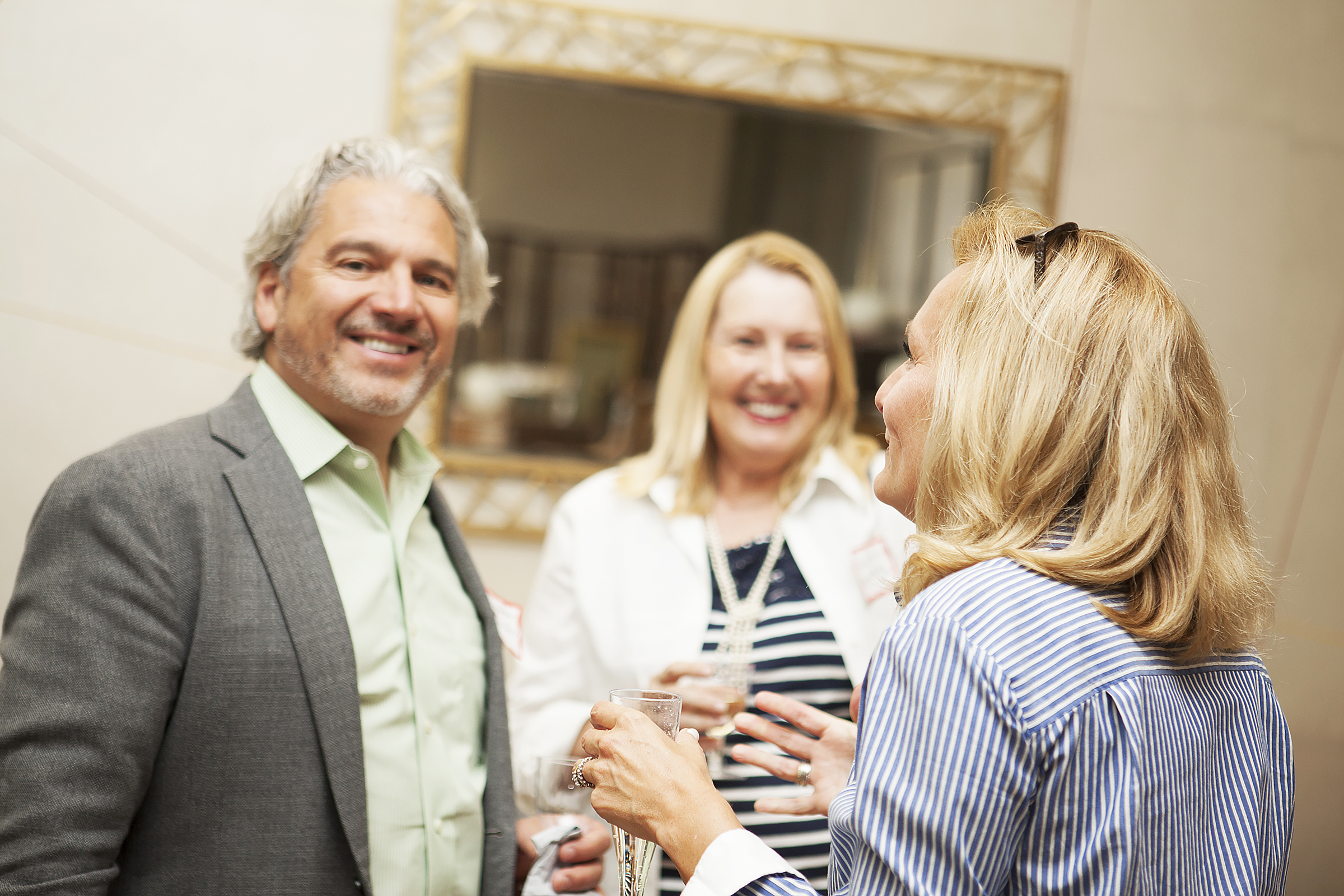From left to right :  Bill Weidner, Director of Business Development for  Sason Builders , shares a moment with Susan Arann, ASID, NCIDQ, of  American & International Designs Inc ., and Donna Herman, Director at   Luxe Interiors + Design .