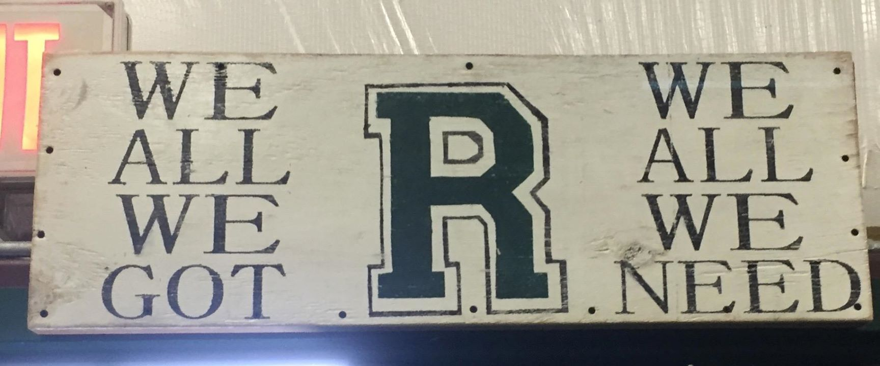 The sign that hangs above the exit of the Roswell Field House