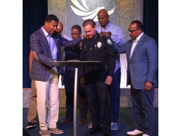 African-American faith leaders praying for Roswell's police chief and department.
