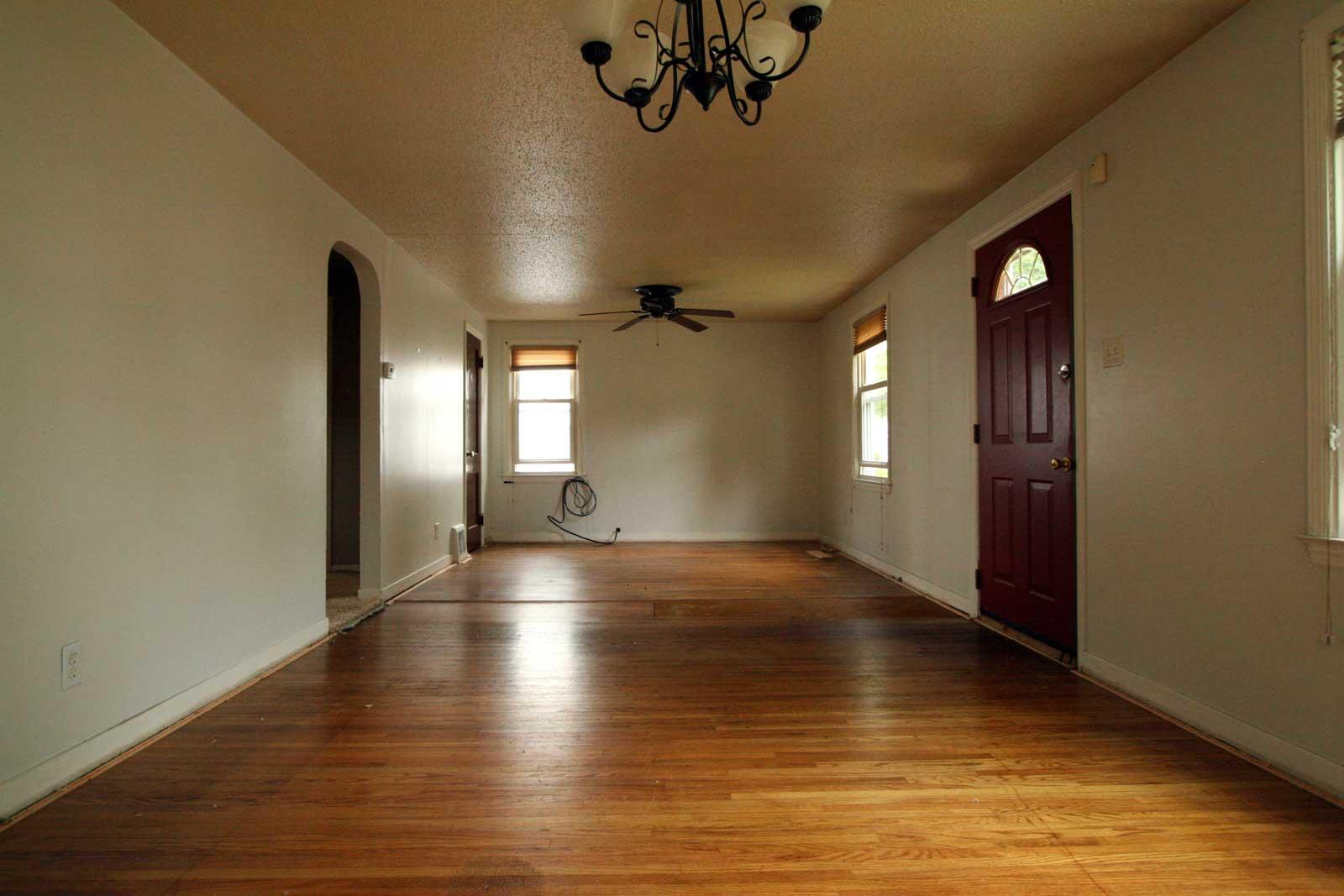 Living/dining space - wood floors under carpet