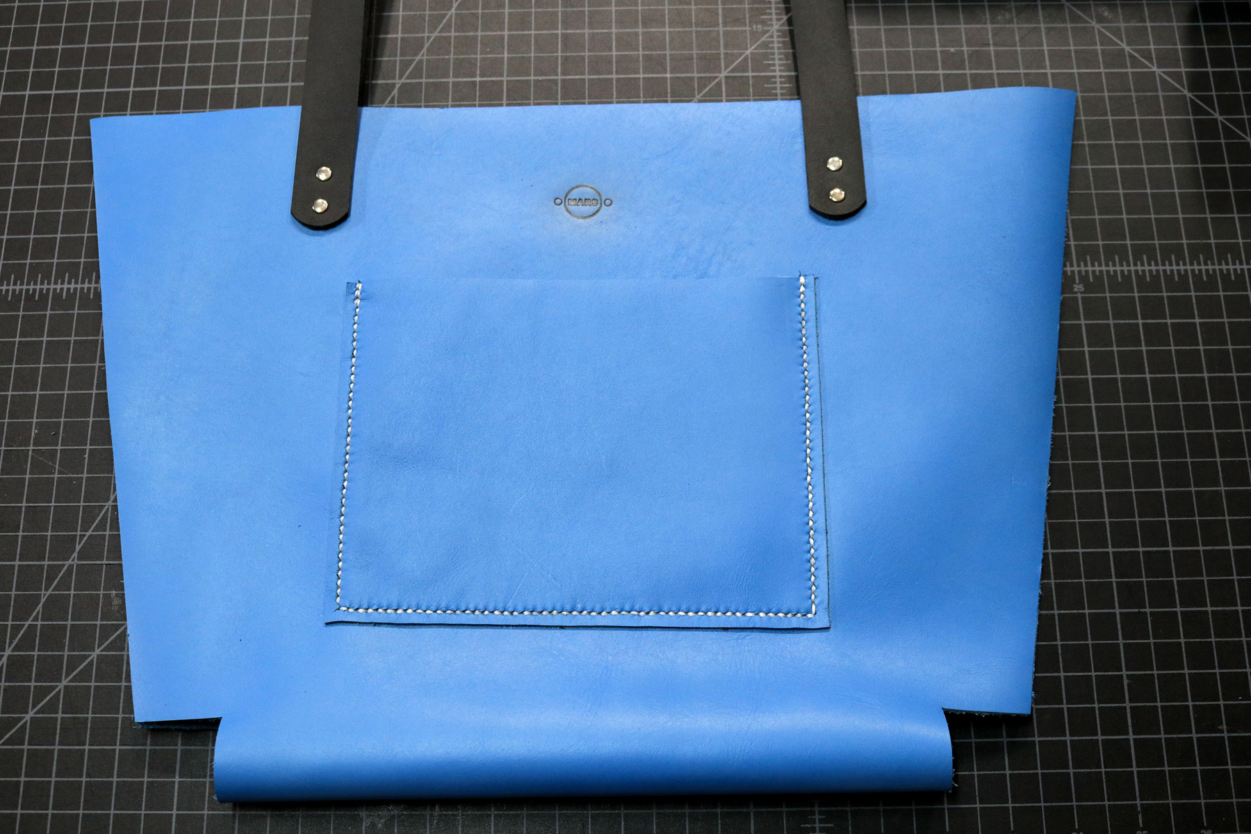 Completed saddle stitching for leather tote bag pockets