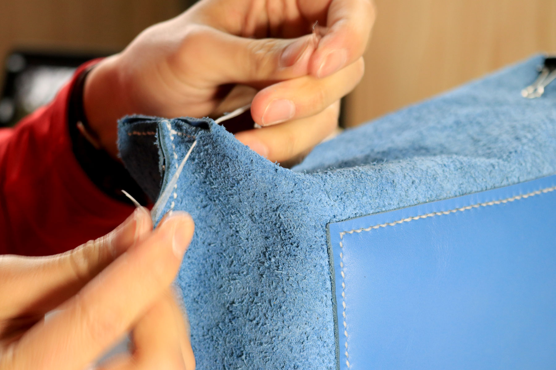 Stitching bottom corners of leather tote bag