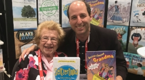 Yes, that's Dr. Ruth Westheimer holding Barry Joesph's  Seltzertopia  and he with her graphic novel,  Roller Coaster Grandma .