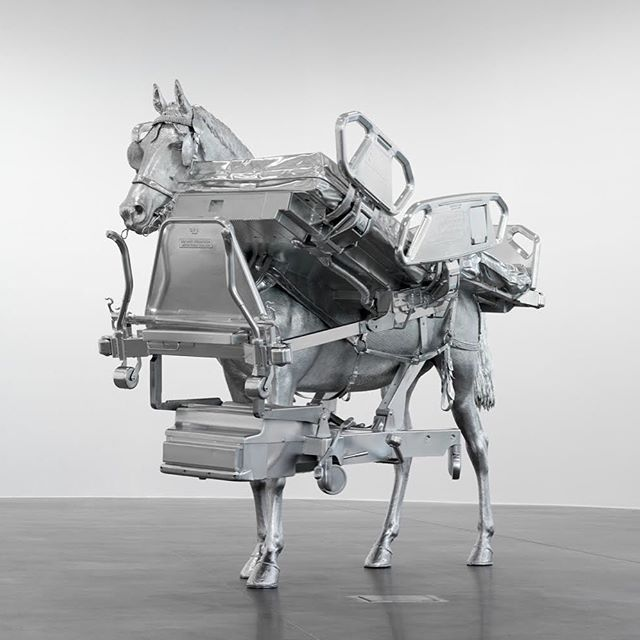 """This unique sculpture is Swiss artist Urs Fischer's """"Horse/Bed"""", which depicts a horse that has fully merged with a hospital bed. The horse stands upright, """"wearing"""" the bed like a harness as though nothing is amiss. Digitally combined from 3-D scans of a taxidermy workhorse and a hospital bed, then milled from aluminum, the detail of the sculpture's impressive materiality provides an overwhelming amount of information to the naked eye.  See """"Horse/Bed"""" alongside the artist's other works at URS FISCHER: ERROR, on view at @thebrantfoundation through October 1, 2019.  Urs Fischer, """"Horse/Bed"""", 2013.    © Urs Fischer. Courtesy of the artist and Gagosian. Photo: Stefan Altenburger."""