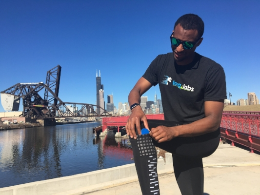 A runner places a wireless sensor into a pocket in a pair of K-tech leggings. The sensors detect gait imbalance and movement asymmetry that can lead to injuries.PHOTO COURTESY OF TORQ LABS