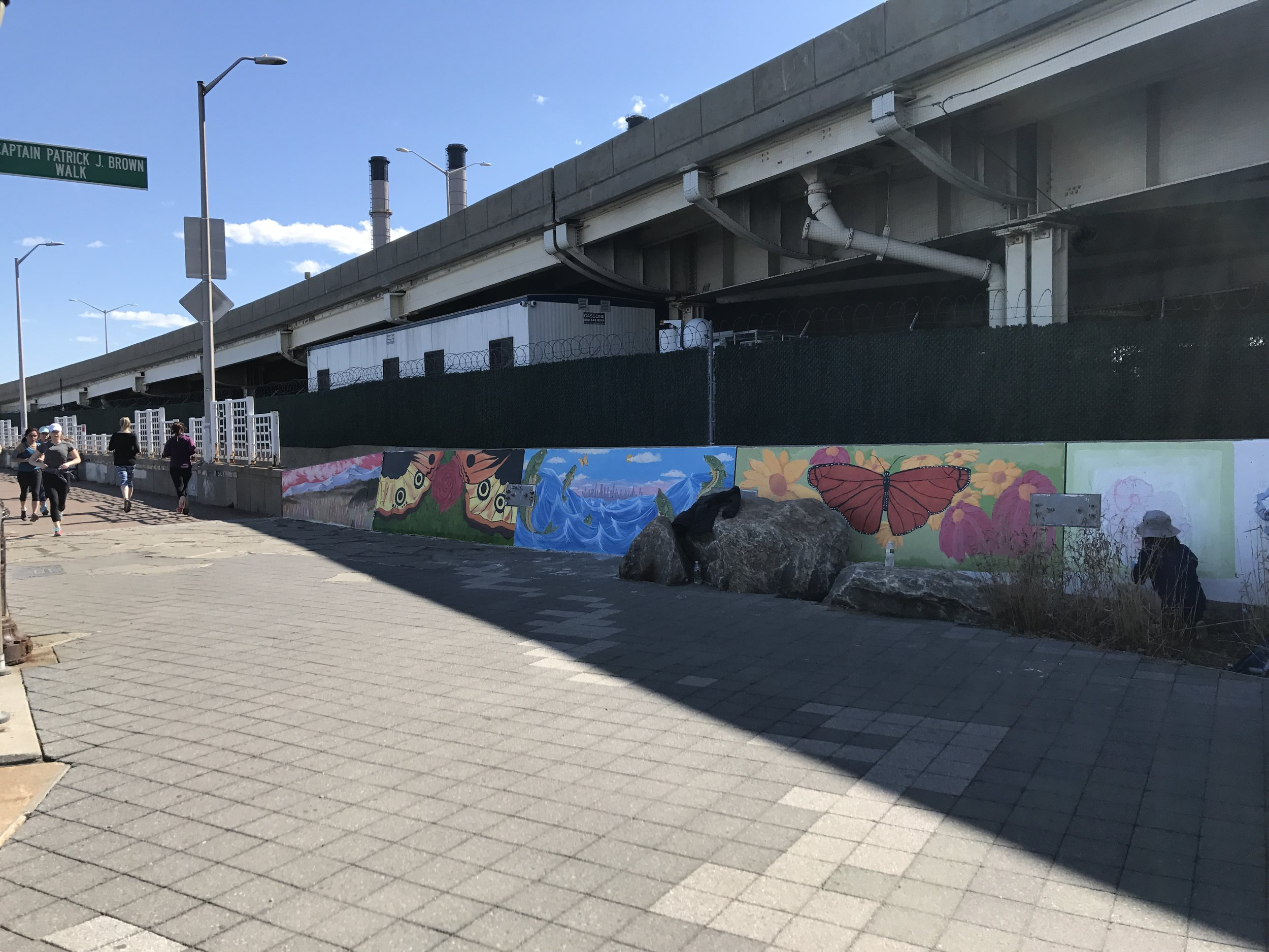 The running path with several finished murals.