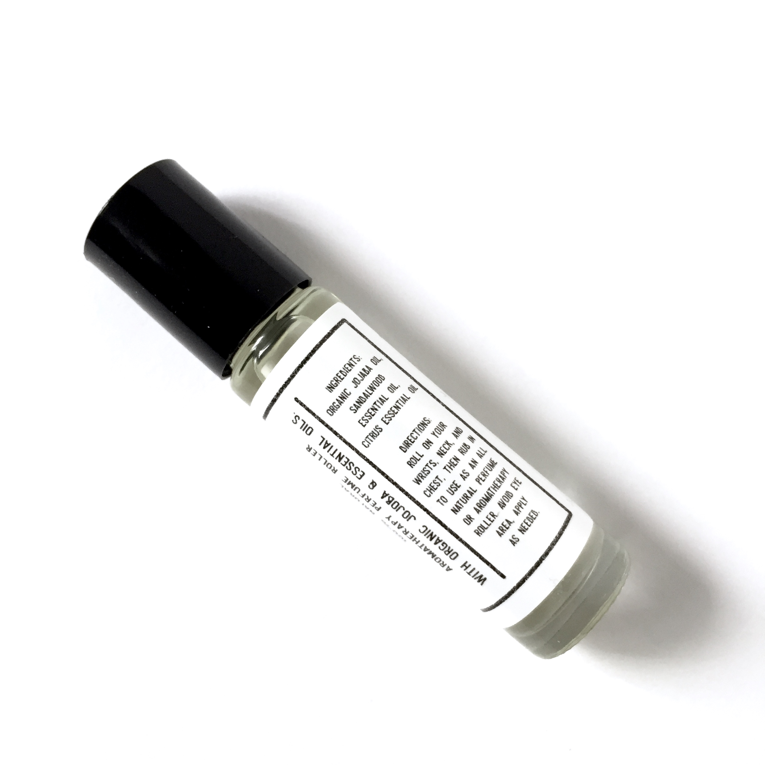 Energizing Sandalwood & Citrus Magic Roller — Five Elements Apothecary