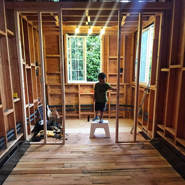 We have finally have lights and a floor!! #tinyfarmhouse #farmhousebuild #tinyhousebuild #tinyhousenation #livingbiginatinyhouse #permaculture #mothernature #upcycle #reclaimedwood #solarpower #dcpower #magic #electrician #electricity #tinyhousebuilder #diytinyhouse