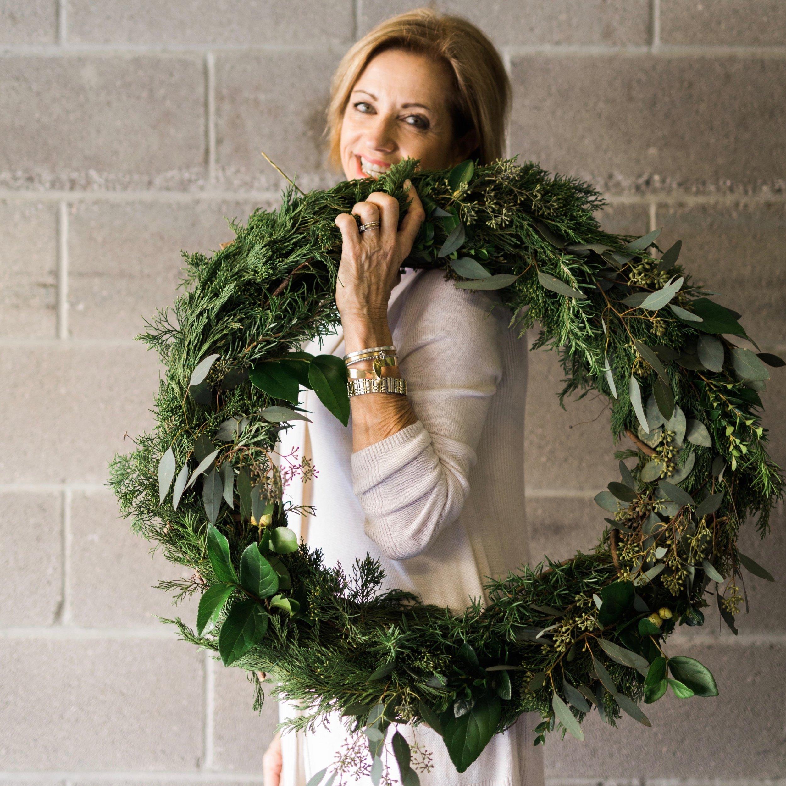 white sweater wreath on shoulder soft smile.jpg