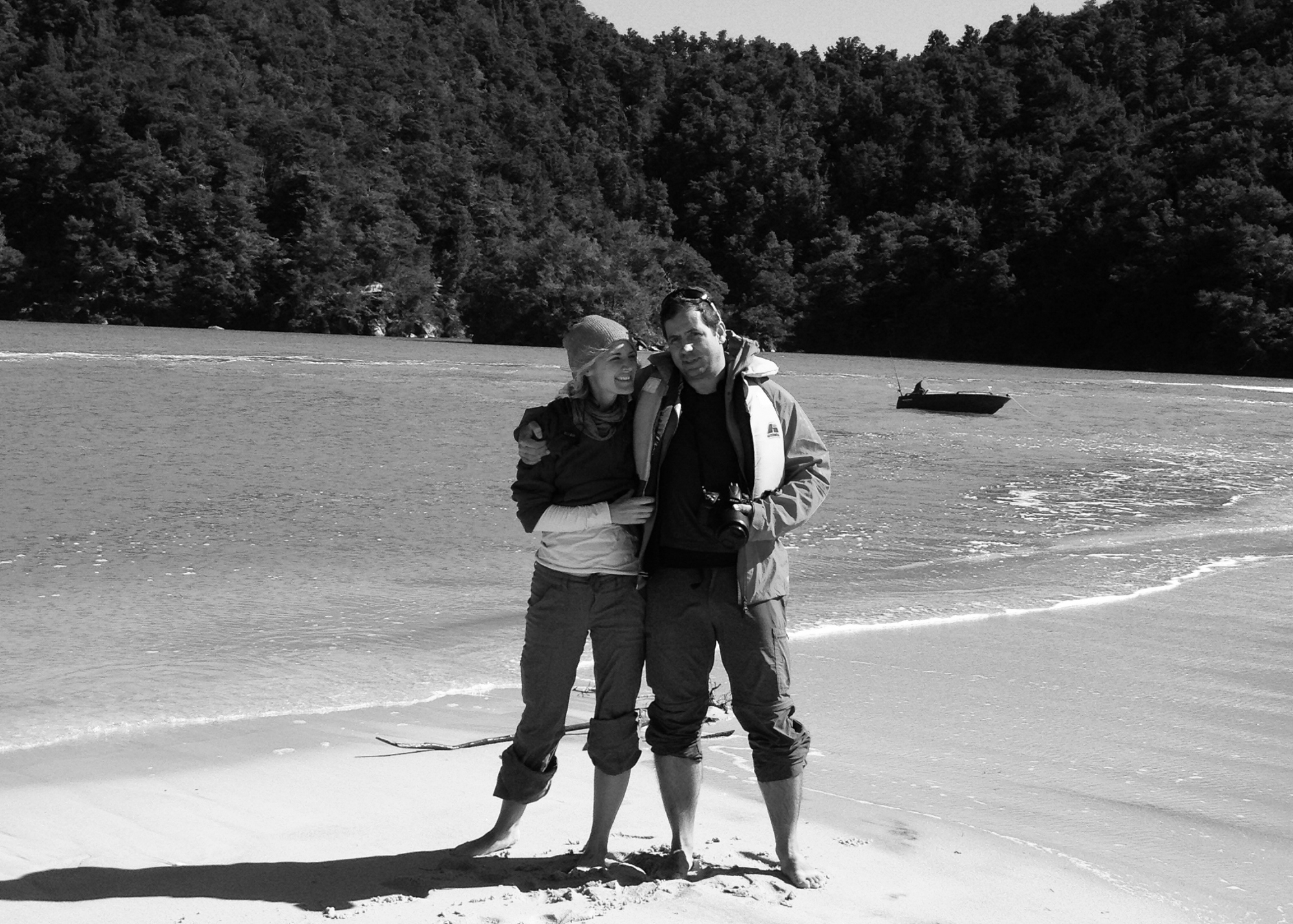 black and white image of a couple on beach in new zealand