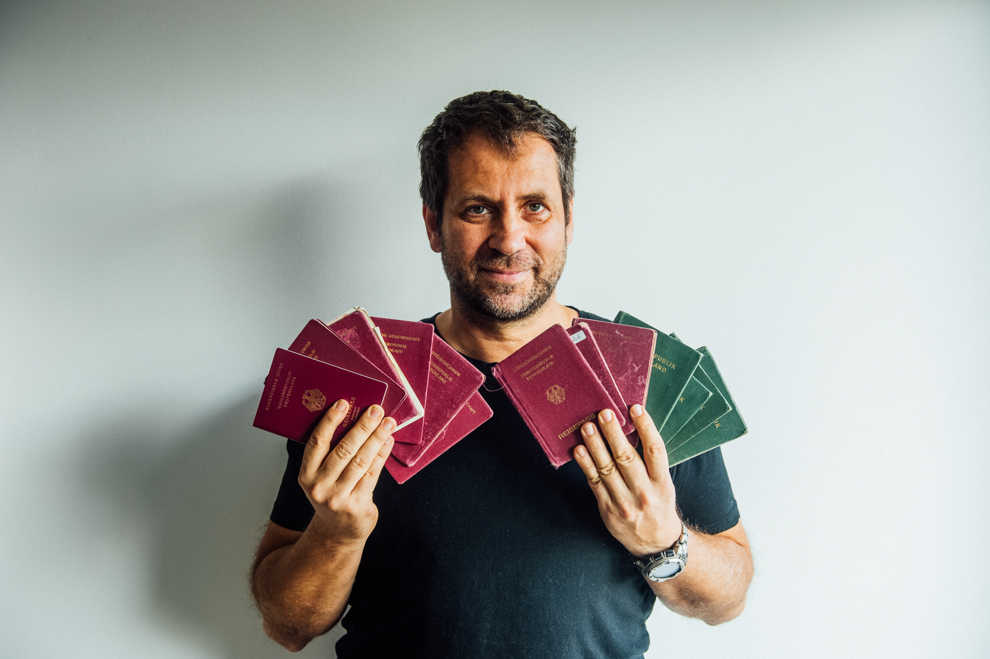 Michael Runkel holds 13 passports after completing traveling through all 193 U.N. countries.